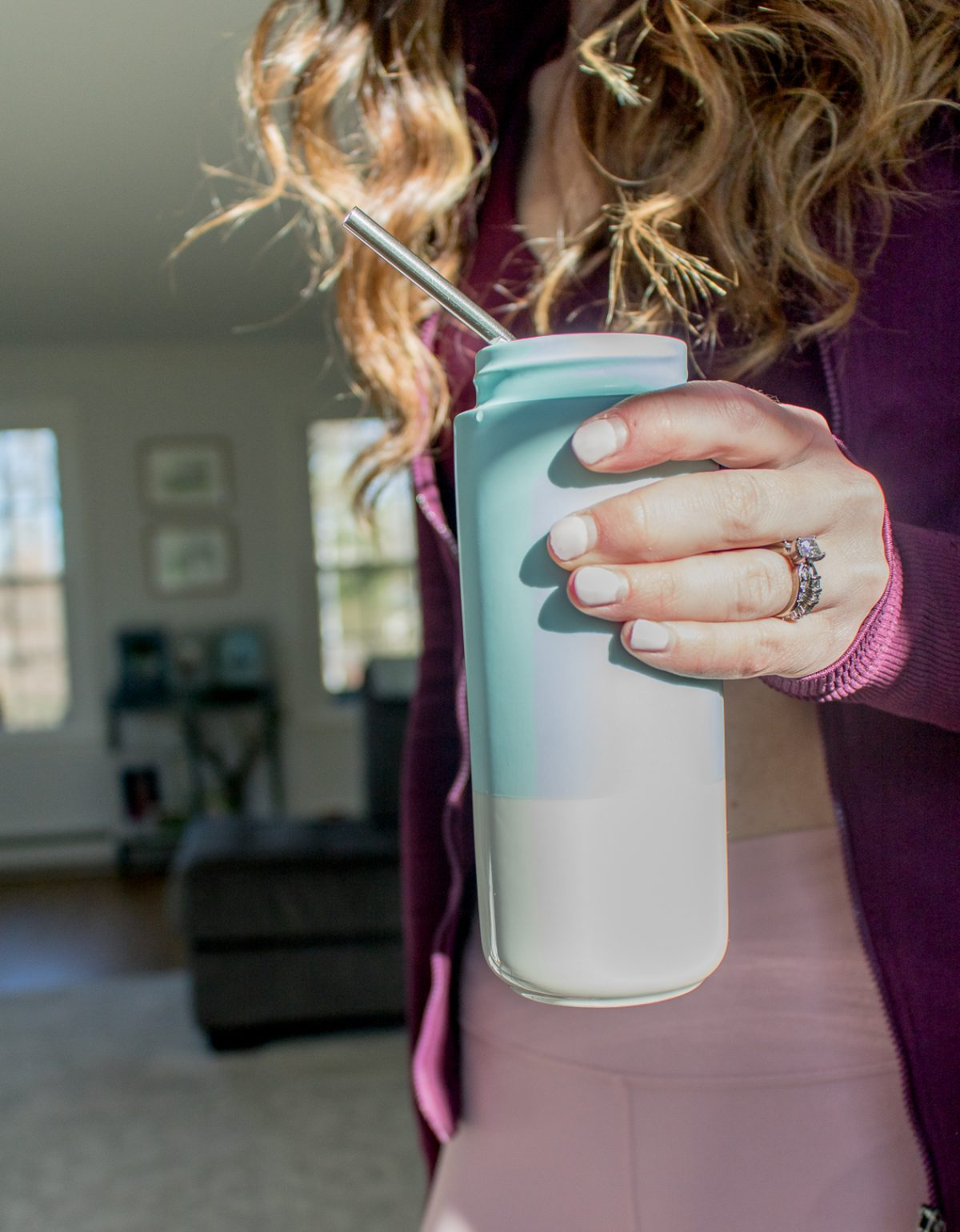 Stainless steel straw in blue reusable water bottle