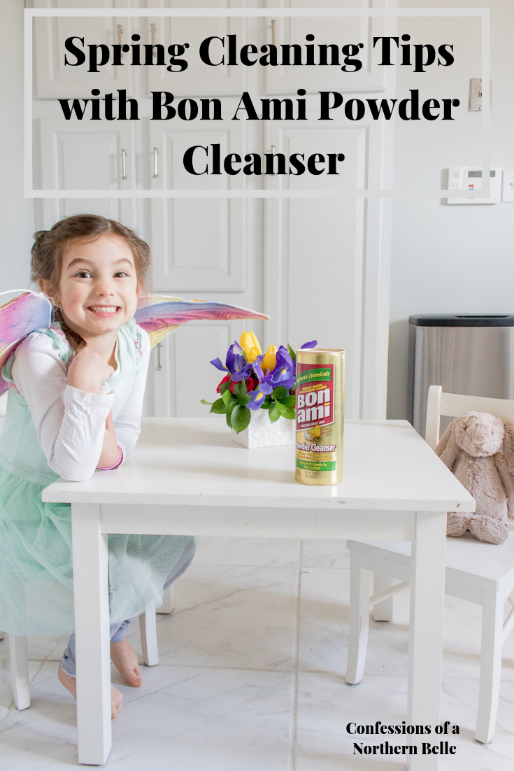 Little Girl wearing fairy wings sitting at a kitchen table for kids with Bon Ami Powder Cleanser with her bunny and a bouquet of flowers