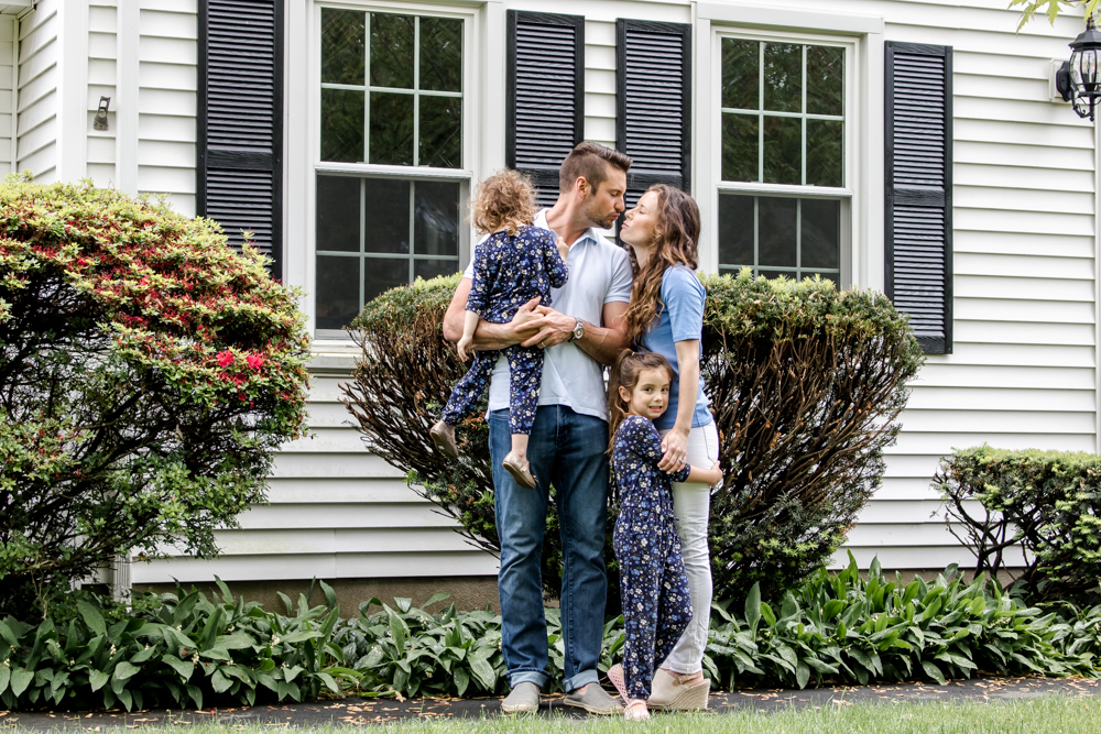 Family of Four in Front of new House
