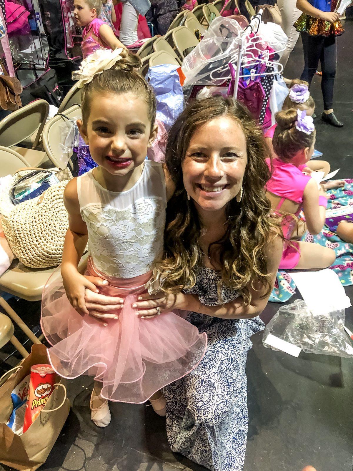Ballerina after her dance recital with Mom