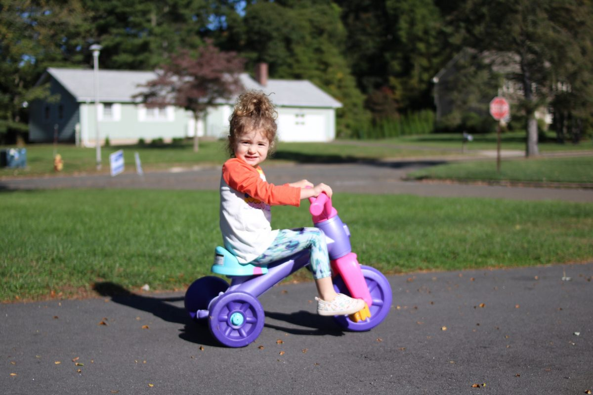 Little girl on tricycle caitlin houston weekend recap