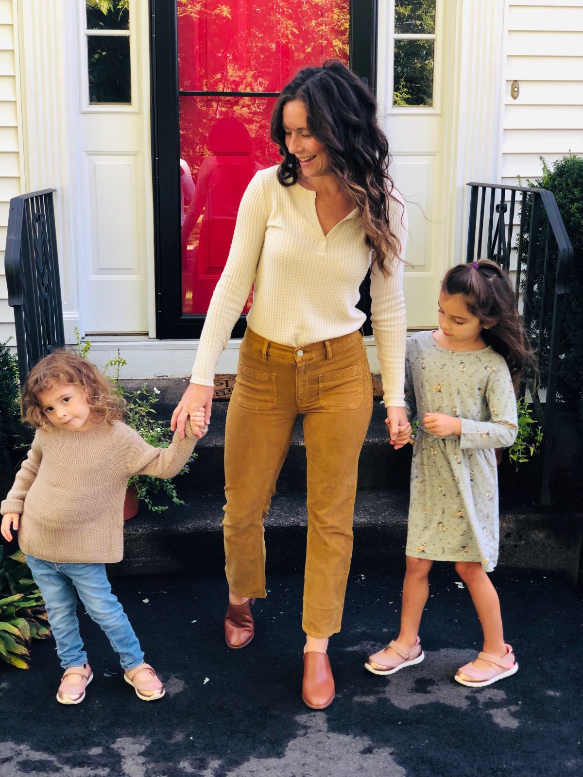 Woman wearing Cropped Corduroy Denim, Waffle Henley, Leather Mules with two little girls