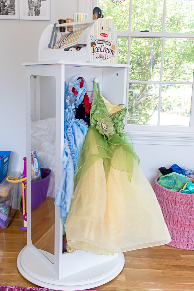 Rotating Costume Organizer in Playroom