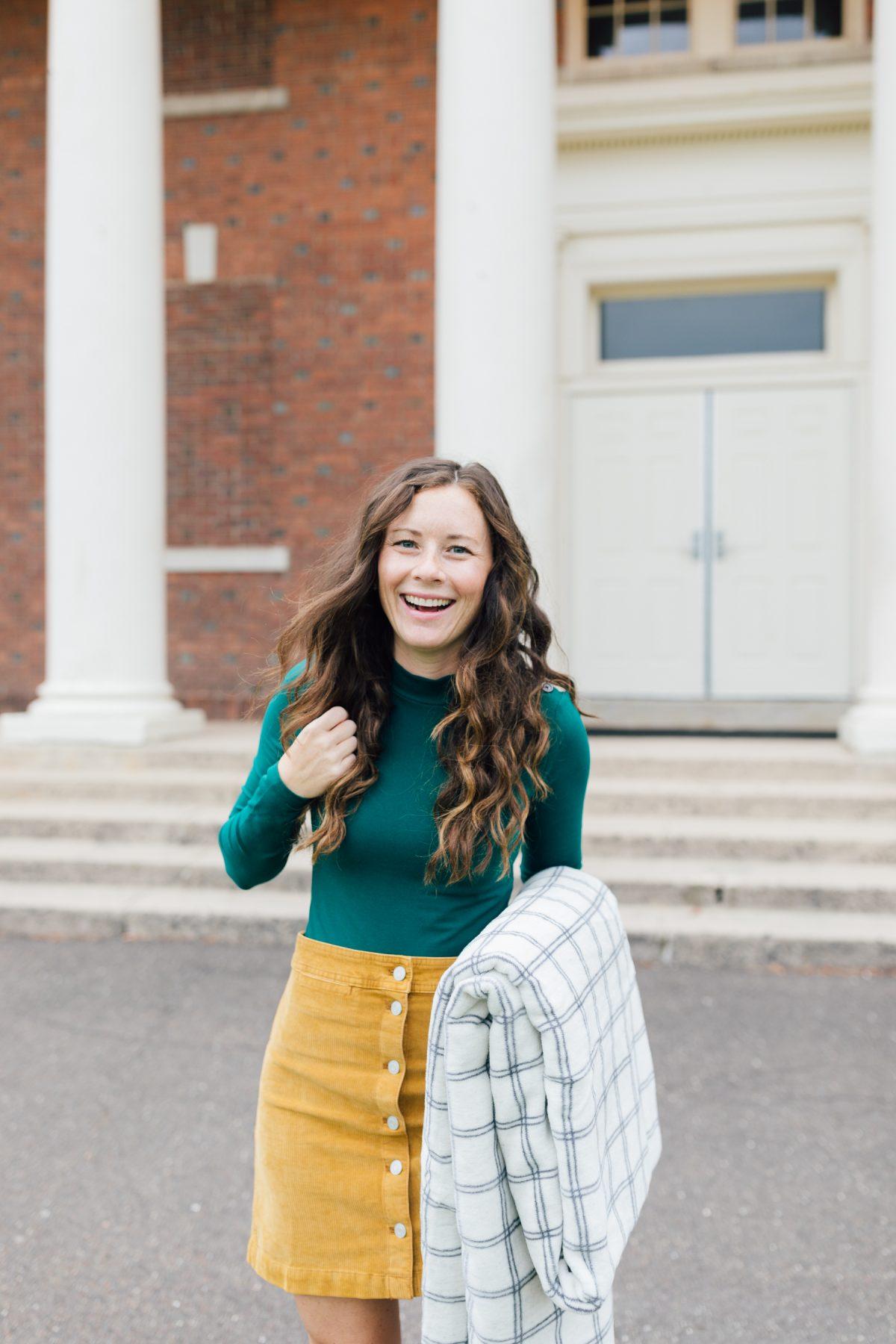 Green bodysuit, yellow corduroy skirt, chappy wrap blanket weekend outfit