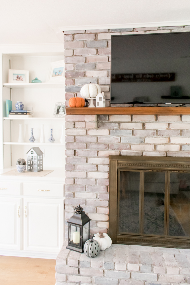 Fall Decor Neutral Colors on Wood Mantle Whitewash Brick Fireplace