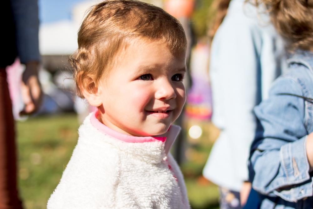 smiling toddler in white fleece