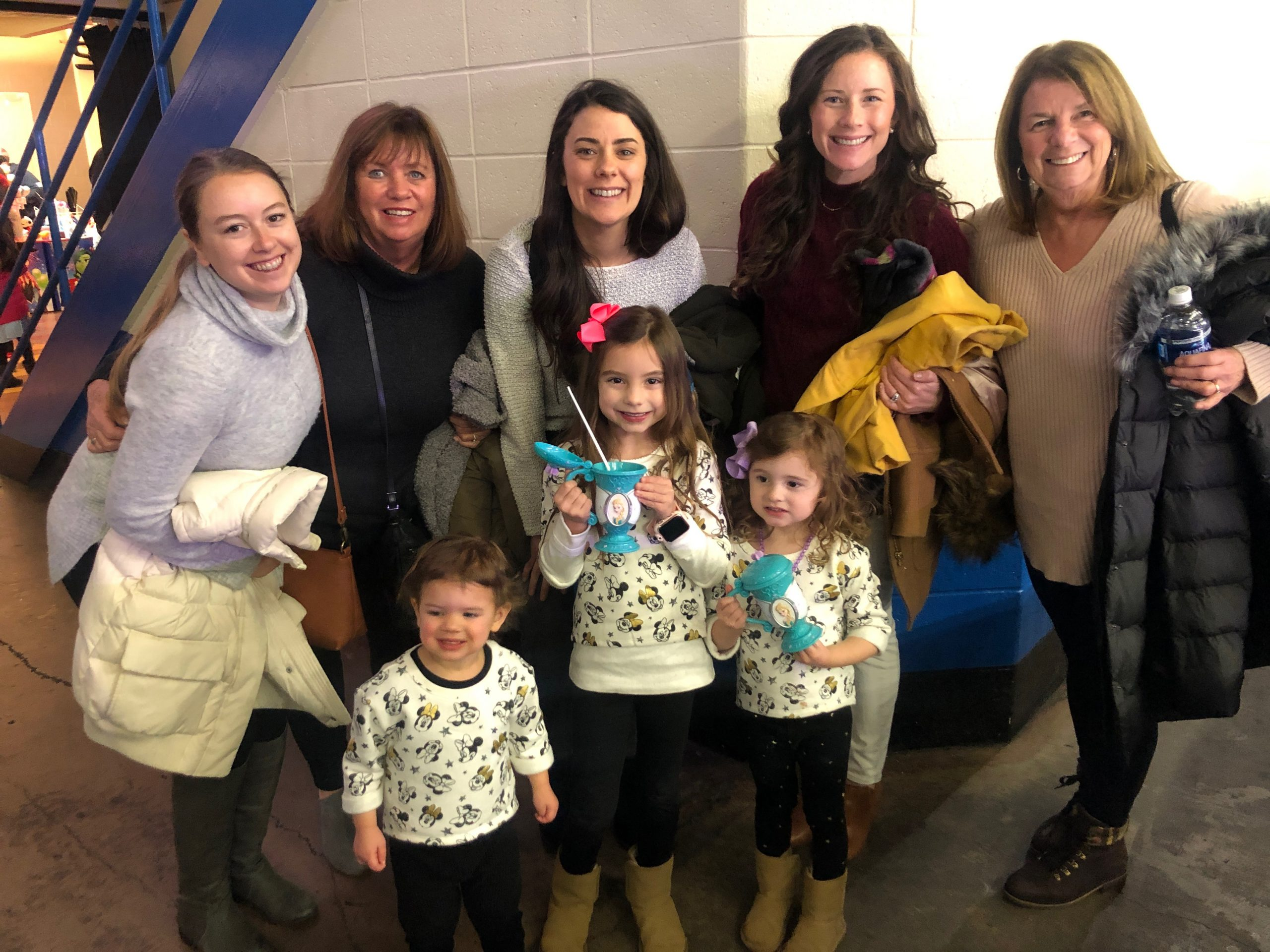 Group of Ladies from toddler to Grandma at disney on ice
