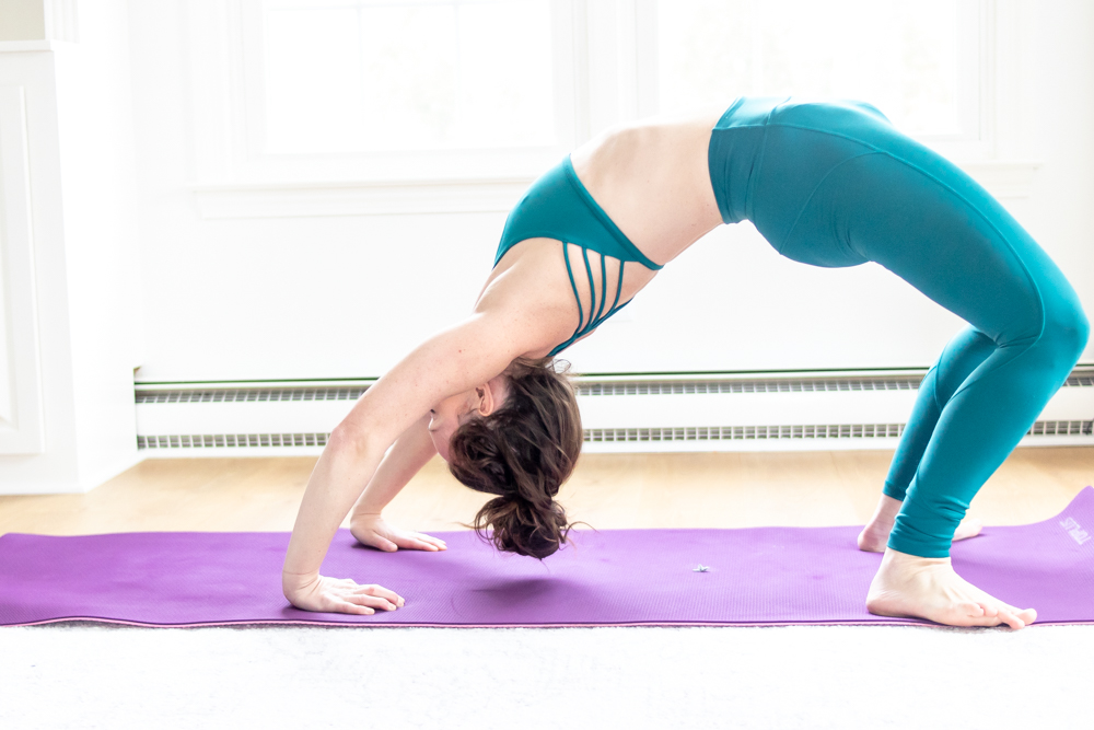 woman in yoga wheel post