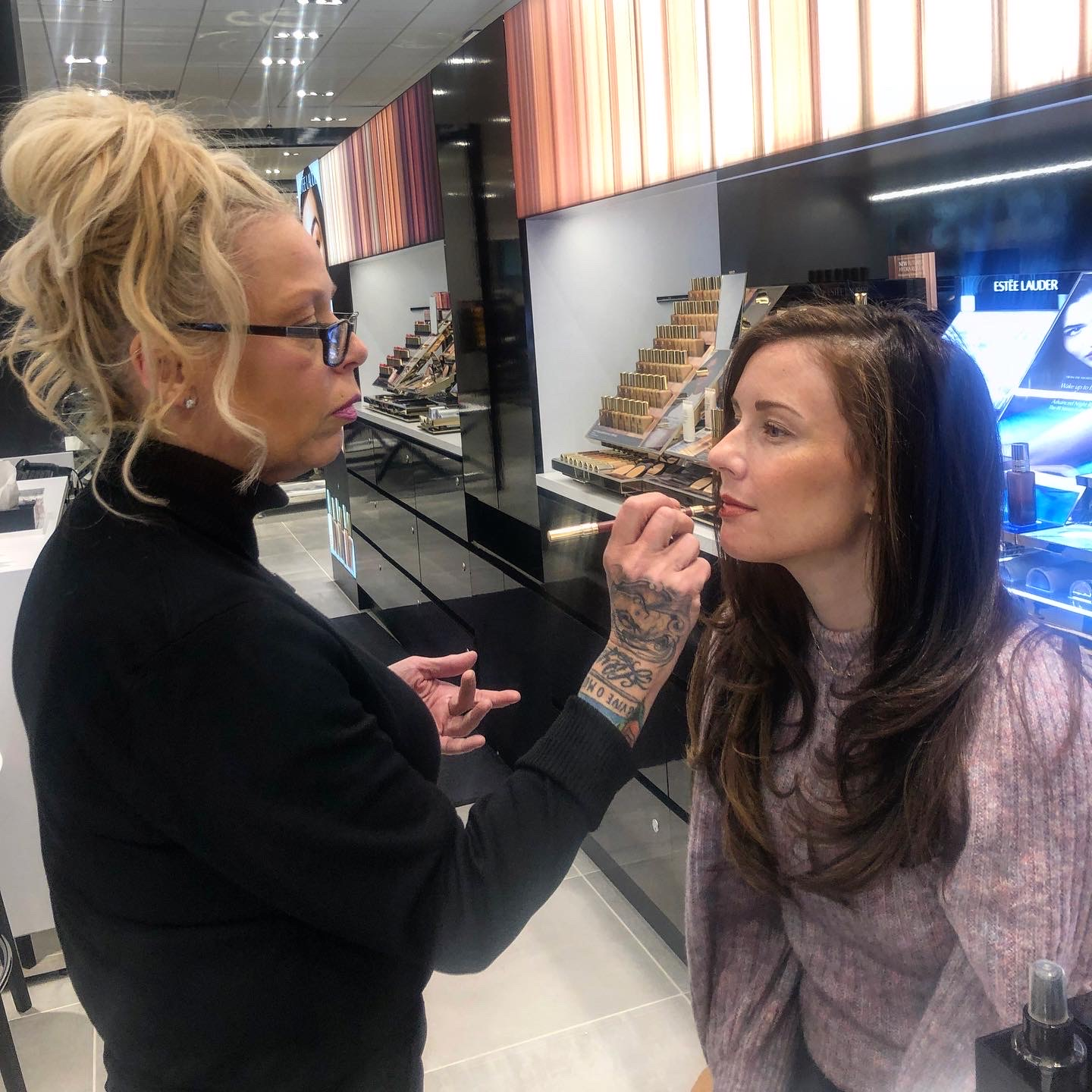 Woman applying lip liner to caitlin houston at bloomingdales