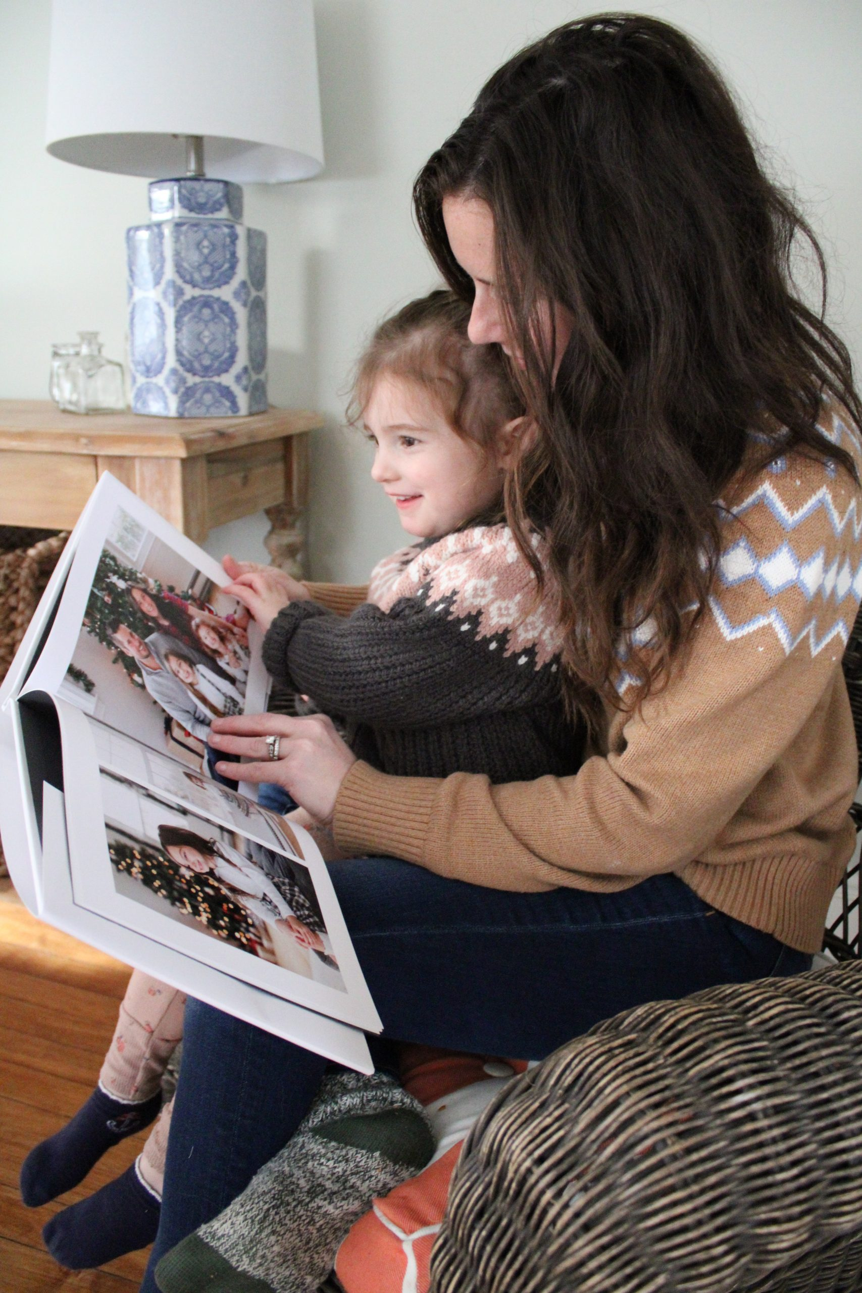 Mom and Daughter looking at Photo Book