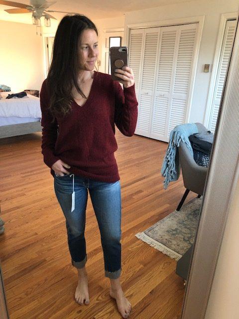 maroon v-neck sweater and cuffed denim