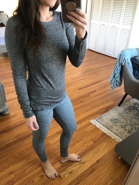 grey athletic top and grey leggings