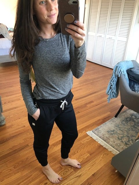 Grey athletic top and black joggers