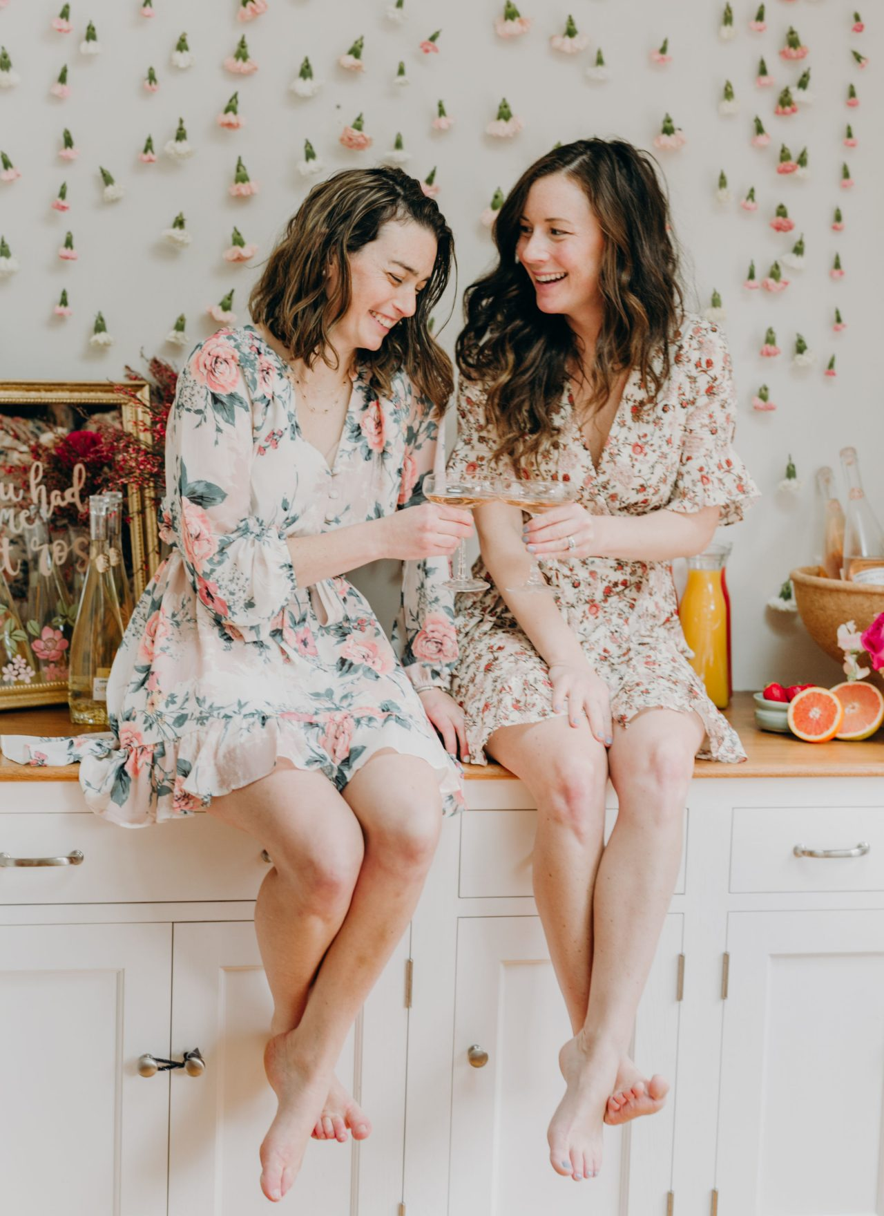 girls in floral dresses cheersing rose