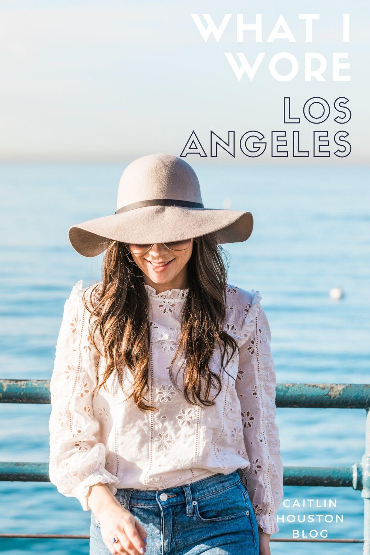 Girl wearing tan wool floppy hat and white eyelet shirt