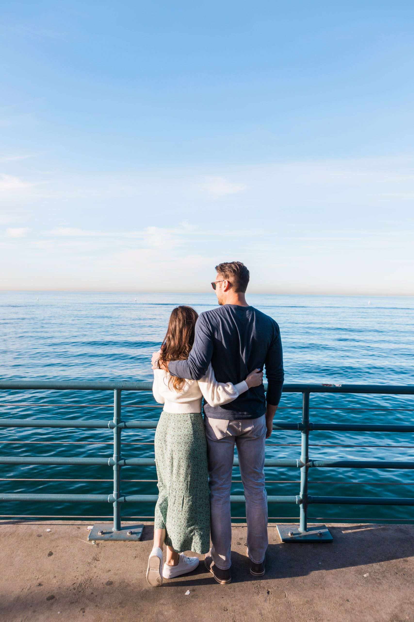 couple overlooking Santa Monica Beach ocean