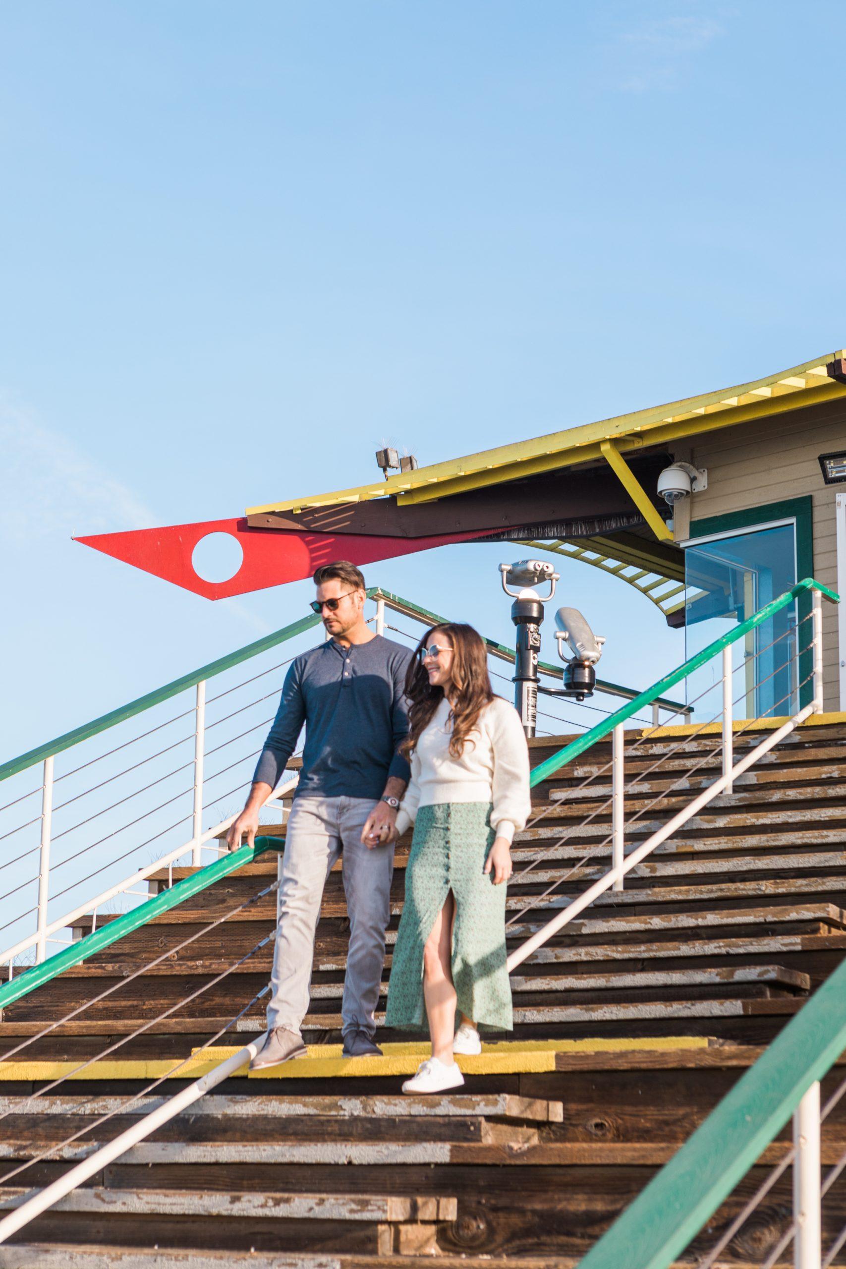 boy and girl walking down stairs at santa monica pier