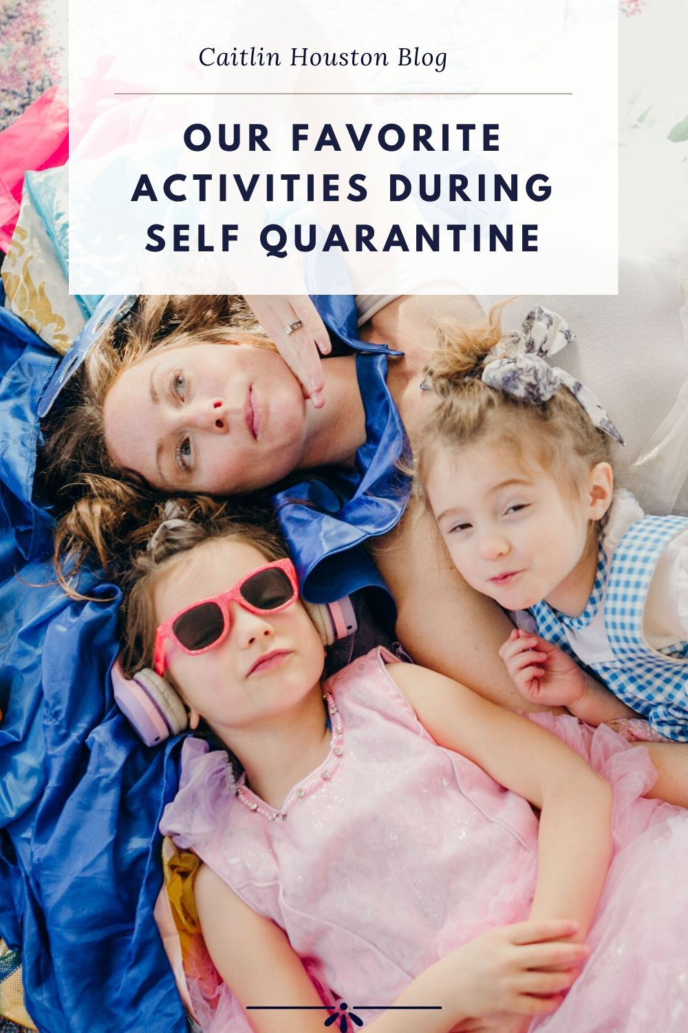 Mom and Daughters laying on dress up clothes during quarantine