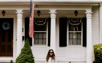 Woman in front of White House American Flag