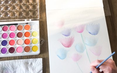 woman painting watercolor flowers