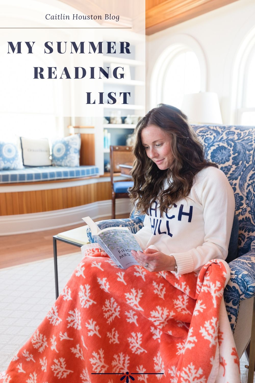 woman sitting with chappy wrap reading a book