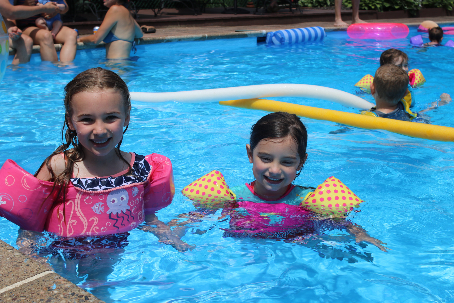 Little Girls Swimming with Puddle Jumpers