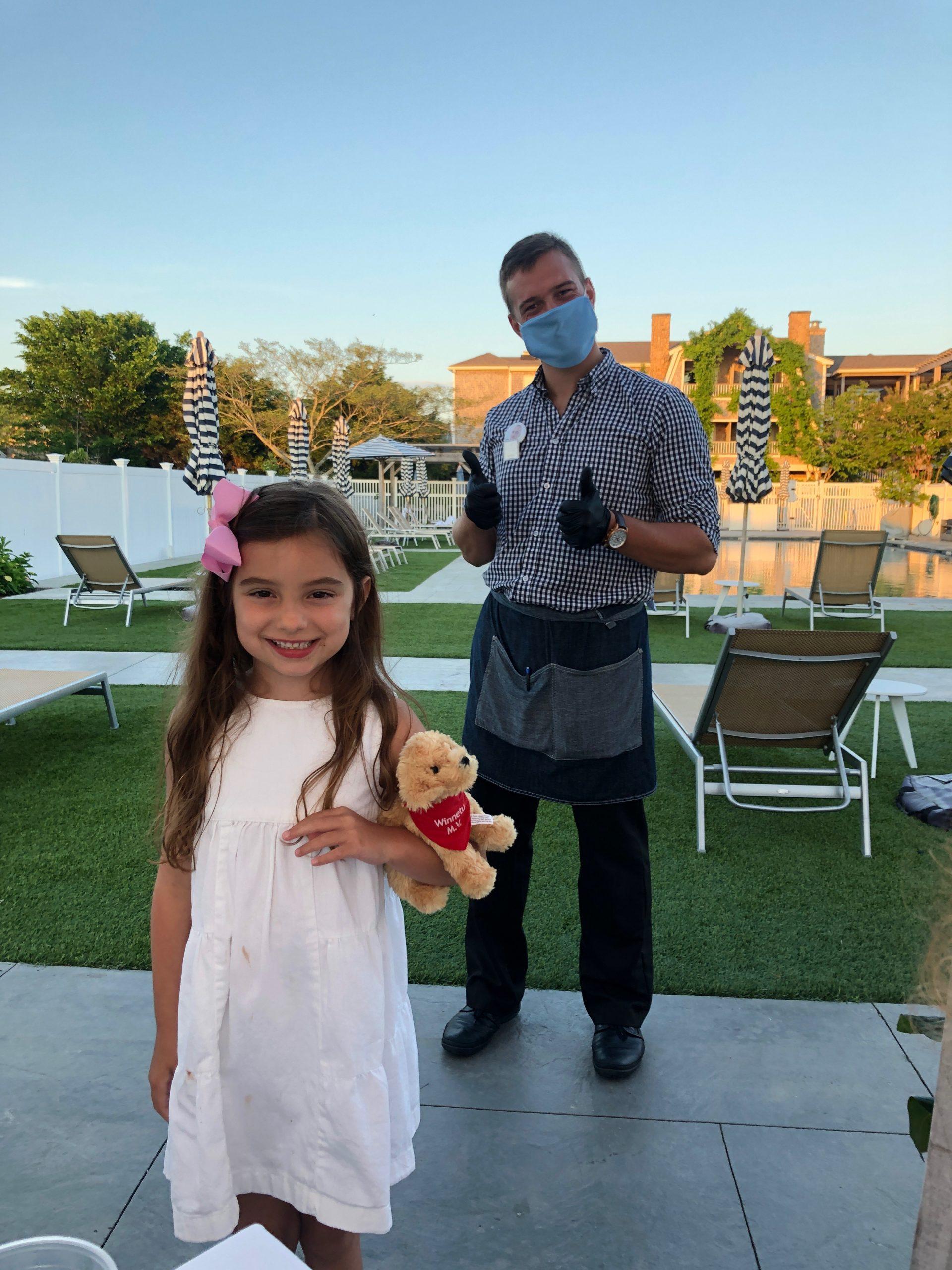 little girl with masked server at Dunes Winnetu
