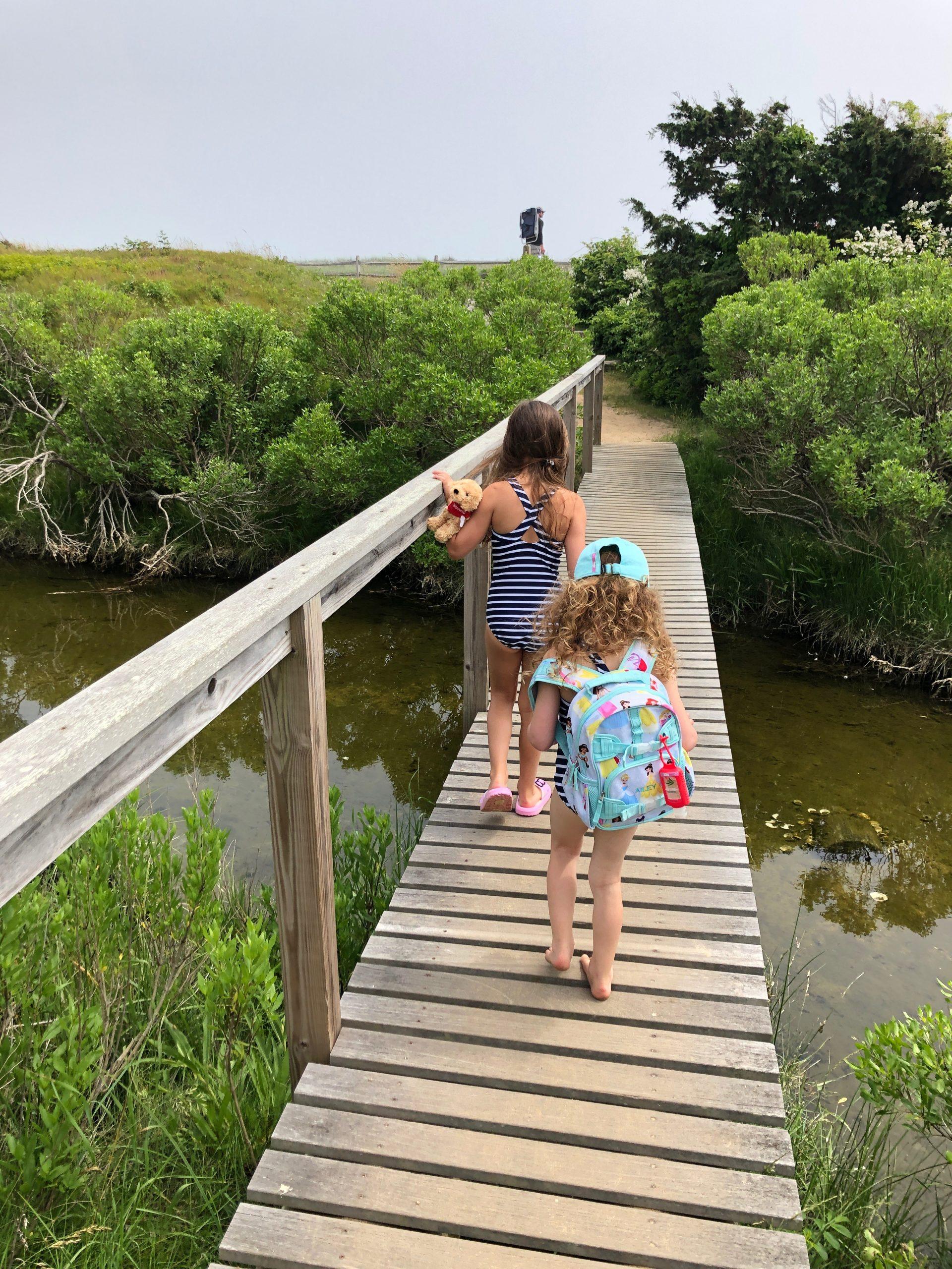 little girls crossing bridge to south beach