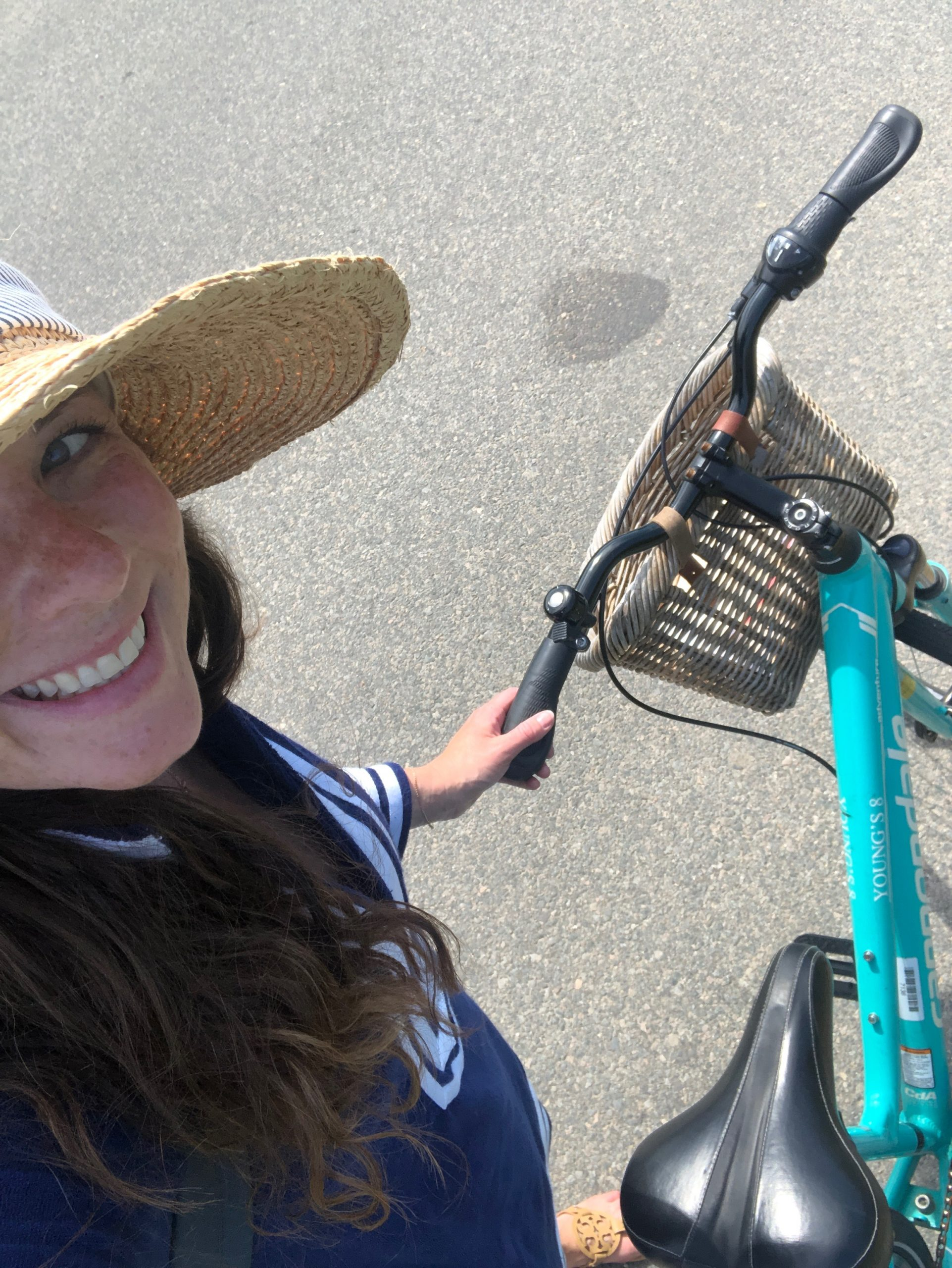 woman riding turquoise bike in nantucket