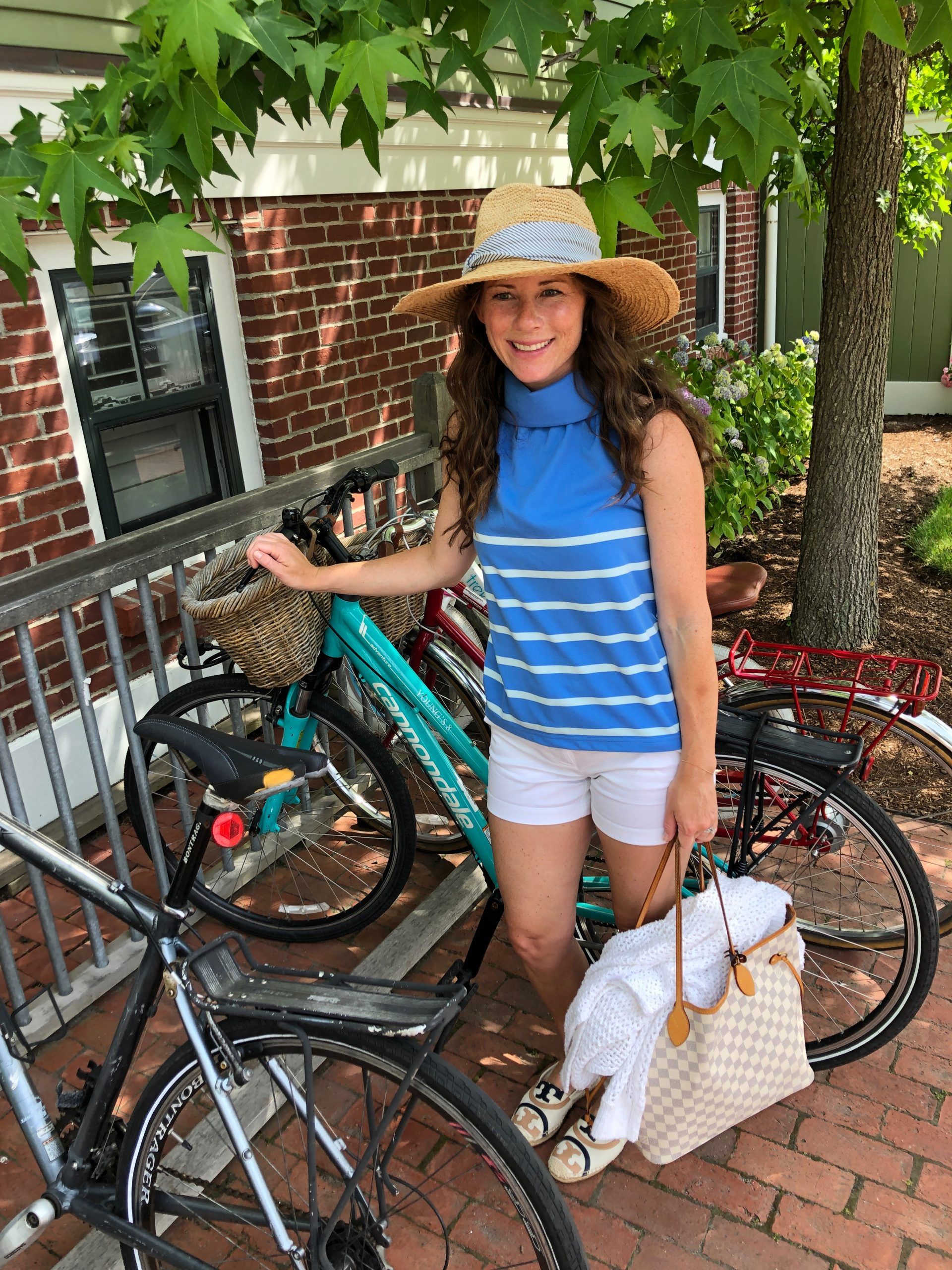 woman standing with bicycle in Nantucket