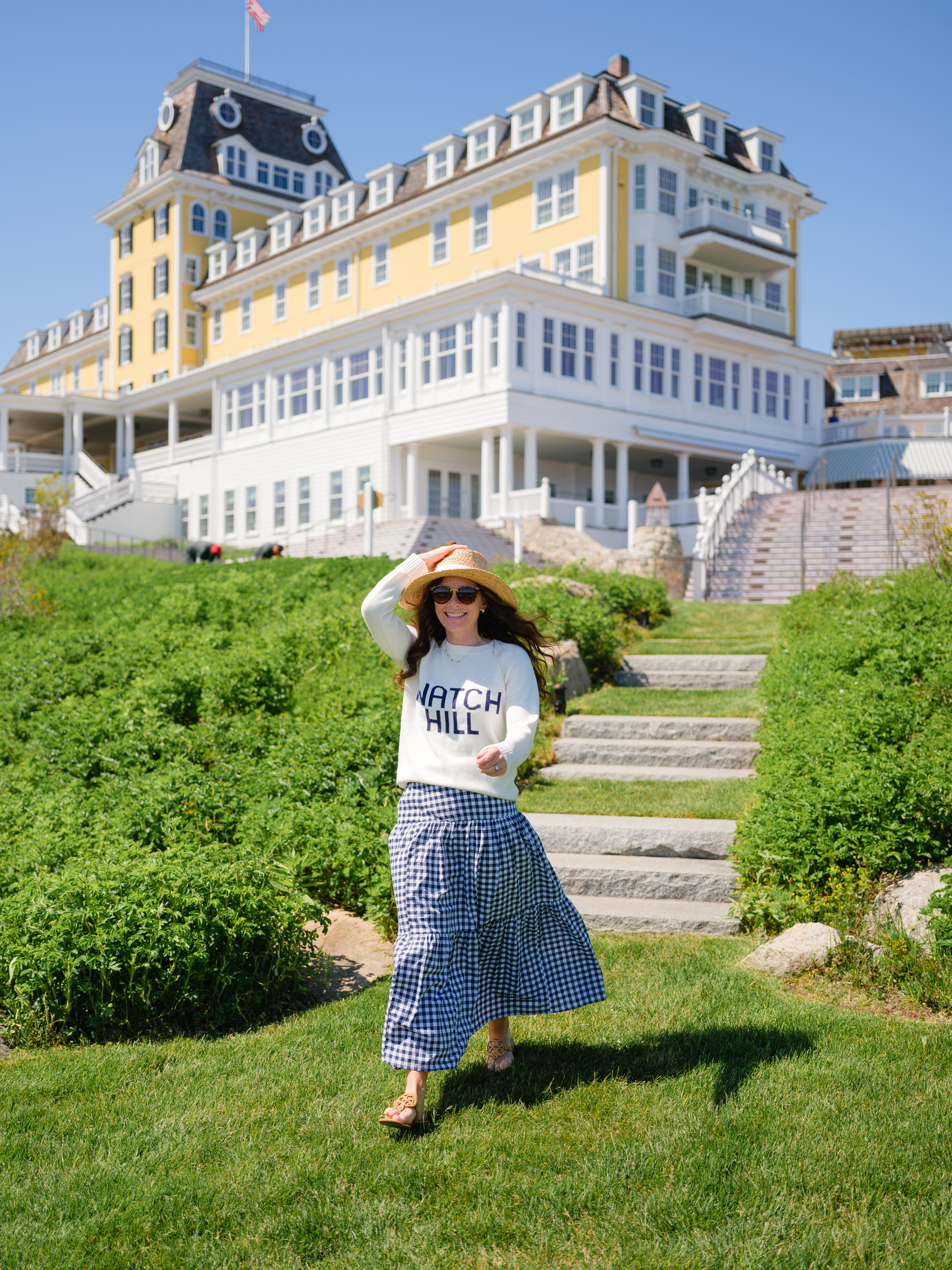woman walking down stairs at Ocean House RI in Watch Hill Sweater and Gingham Skirt loving lately