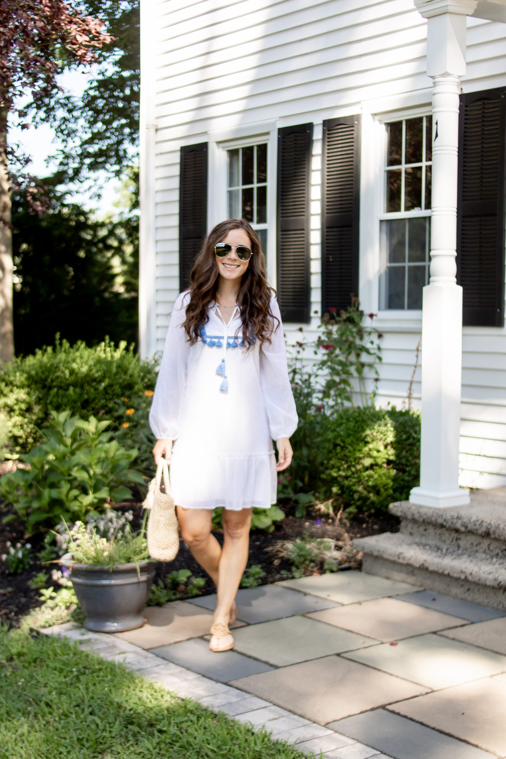 woman in white sail to sable dress for summer from monelle vermont
