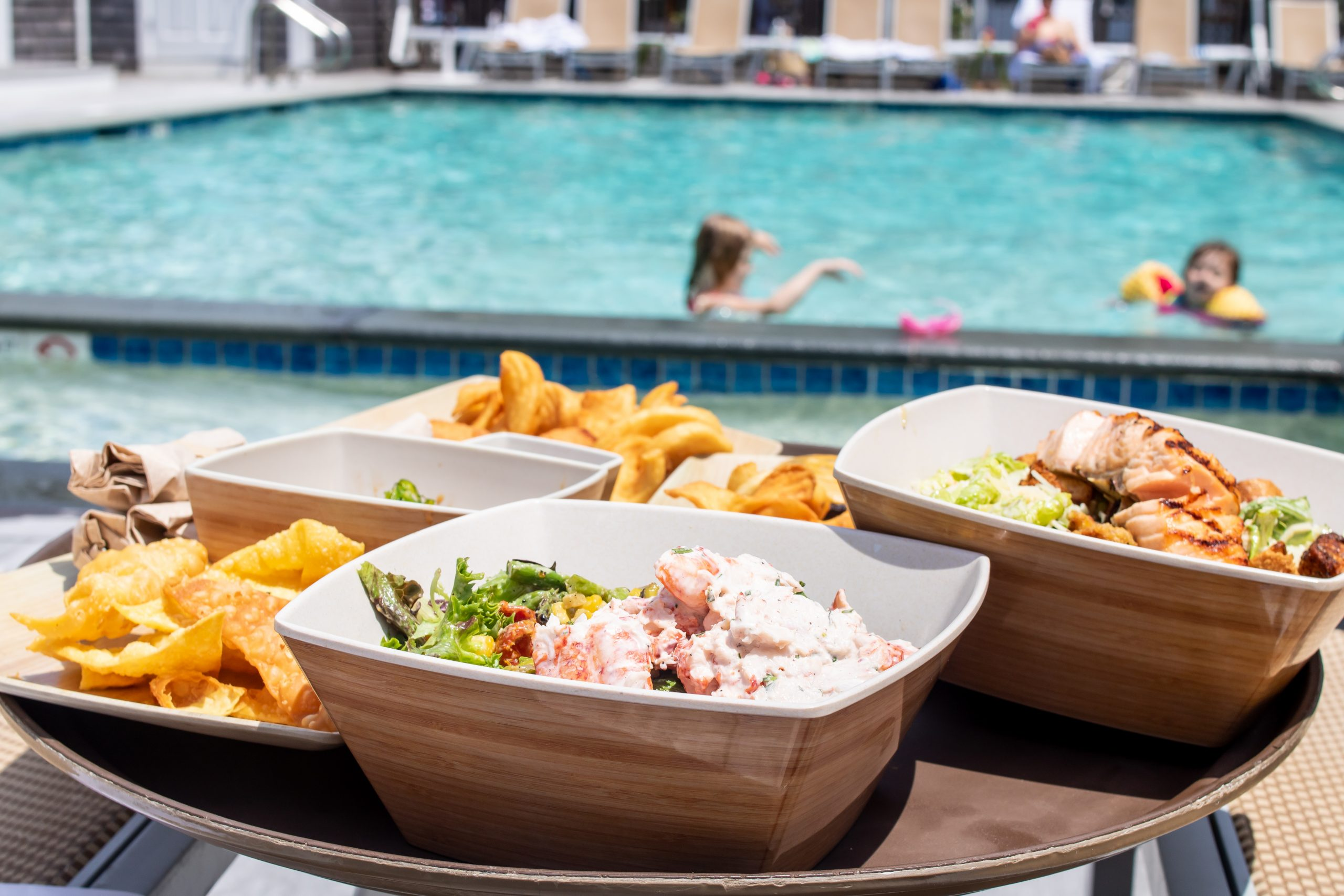 Poolside Lunch at the Nantucket Hotel from Breeze - featuring The Breeze Signature Salad topped with Lobster Salad and curly sea salt fries