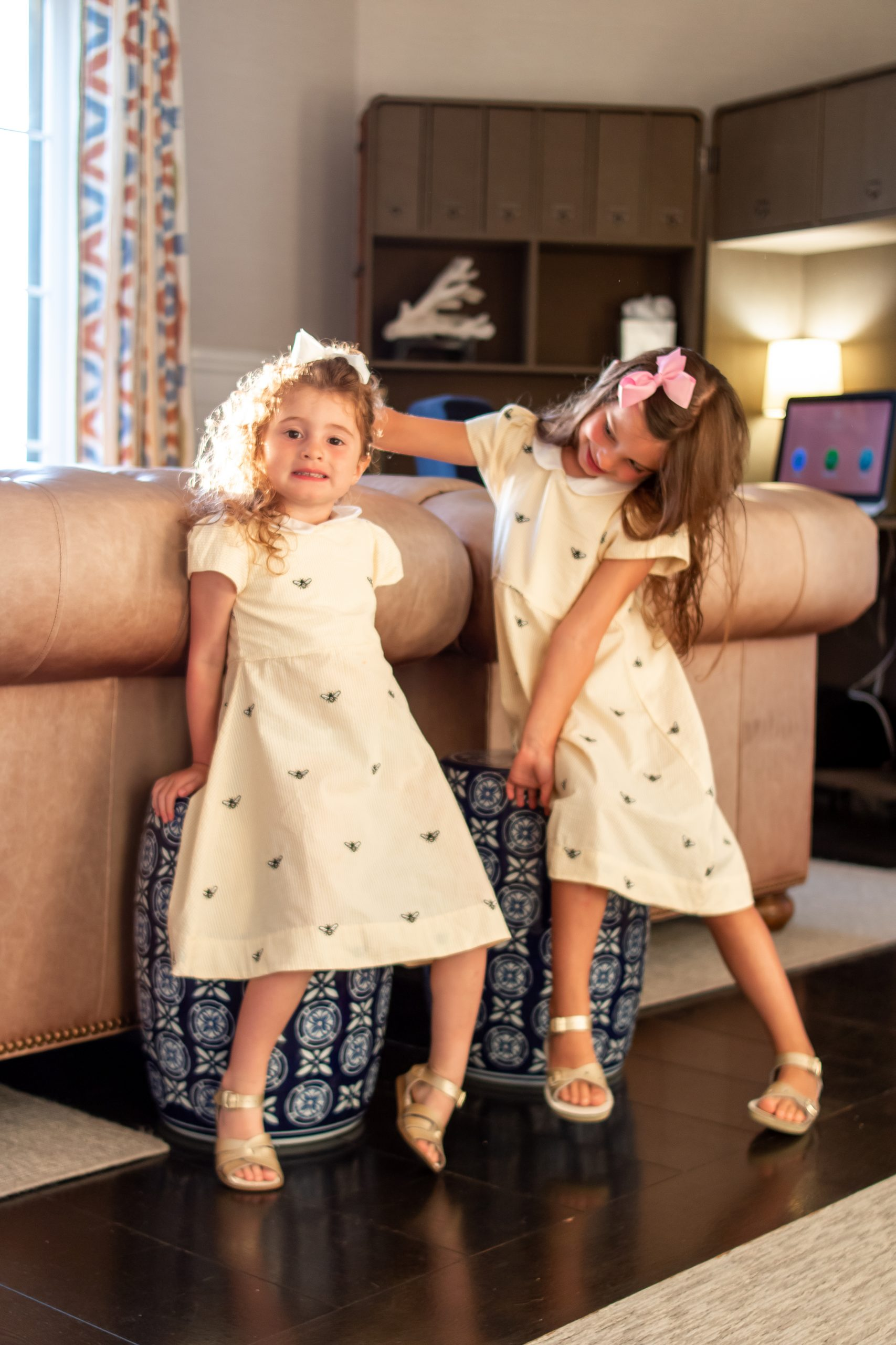 little girls in Piping Prints yellow bee dresses