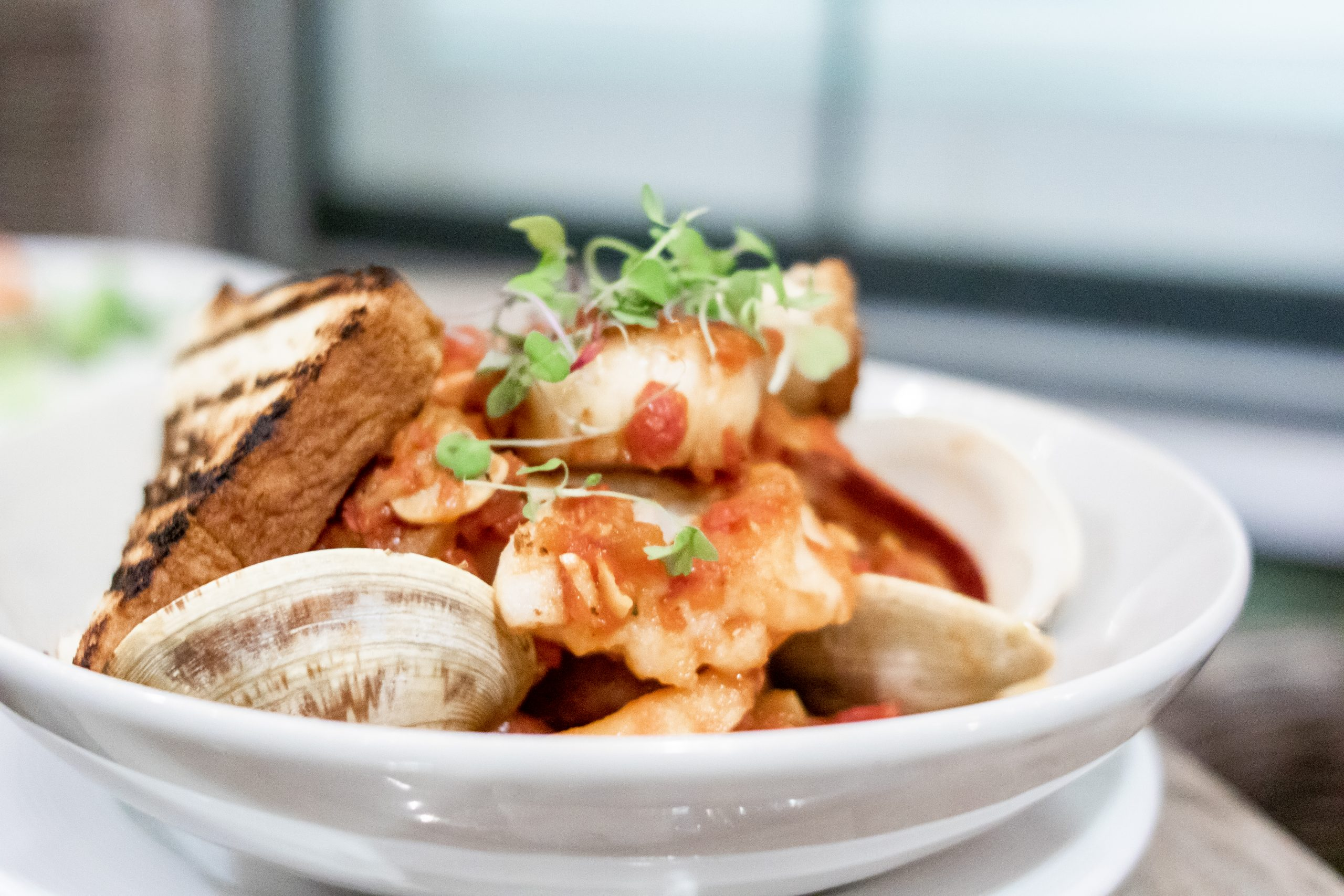 Seafood Stew with saffron tomato broth | mussels - scallops – codfish - lobster