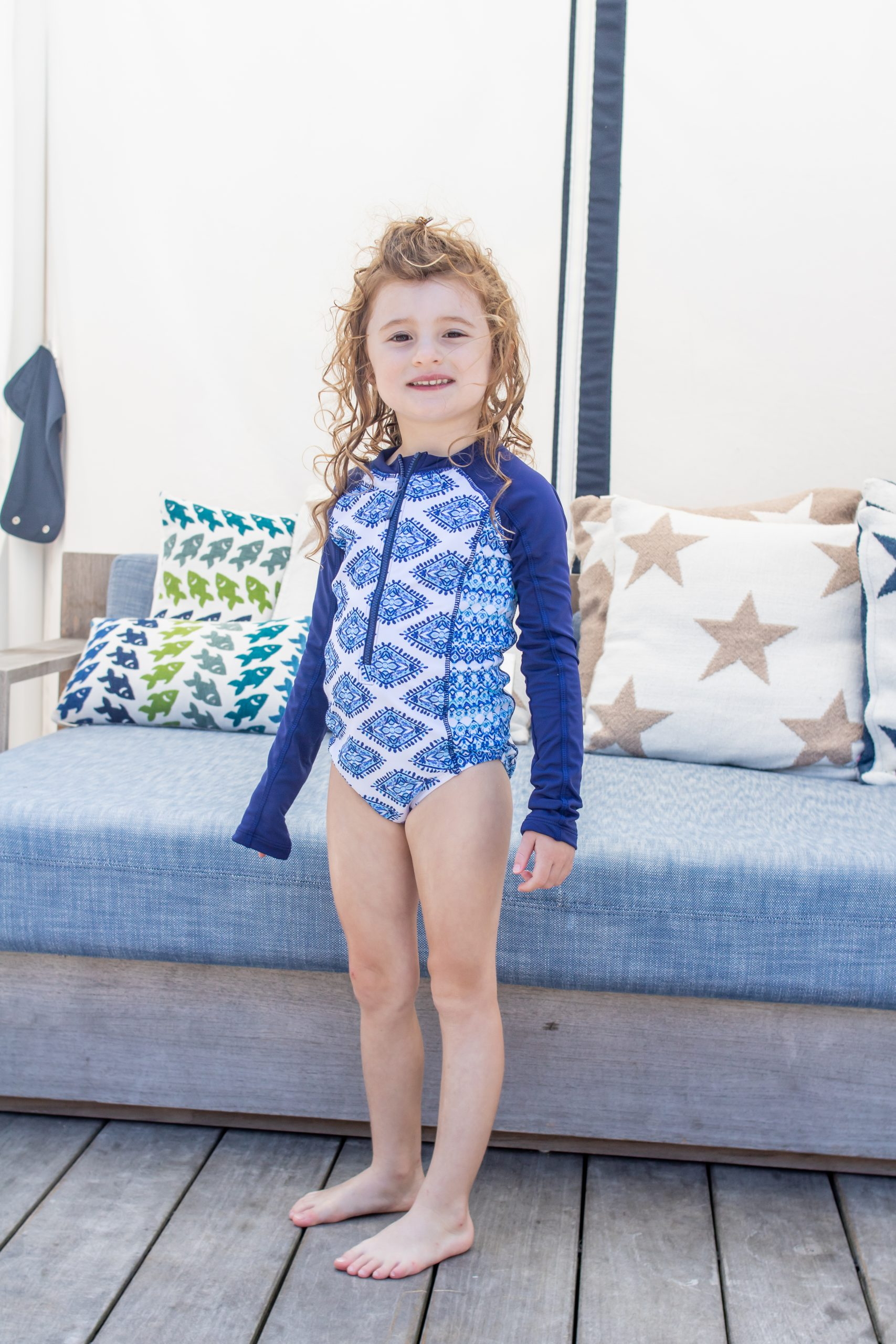 Little girls wearing sun safe Cabana life unisuit bathing suit at the Nantucket Hotel and Resort