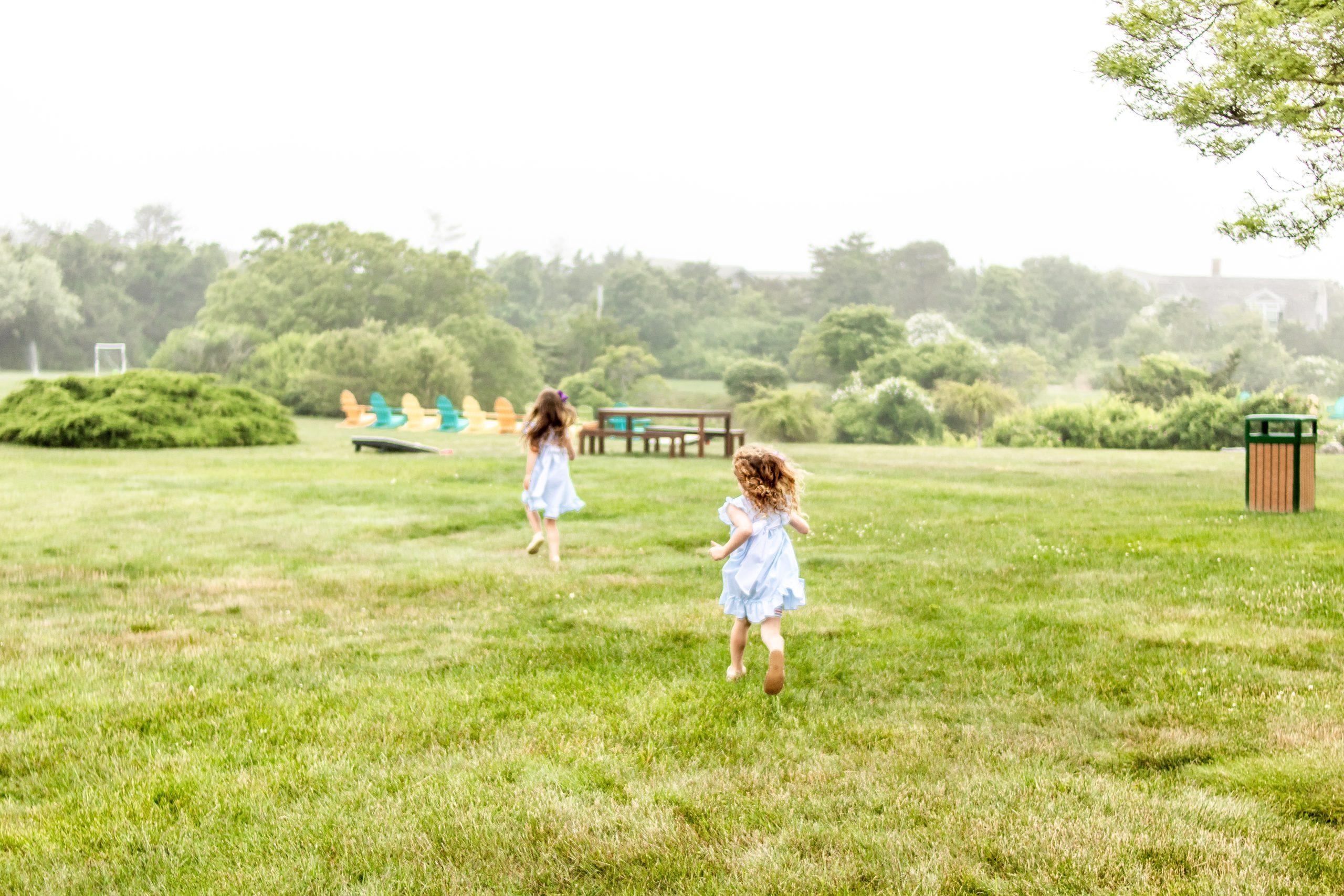 little girls running across the lawn at Winnetu