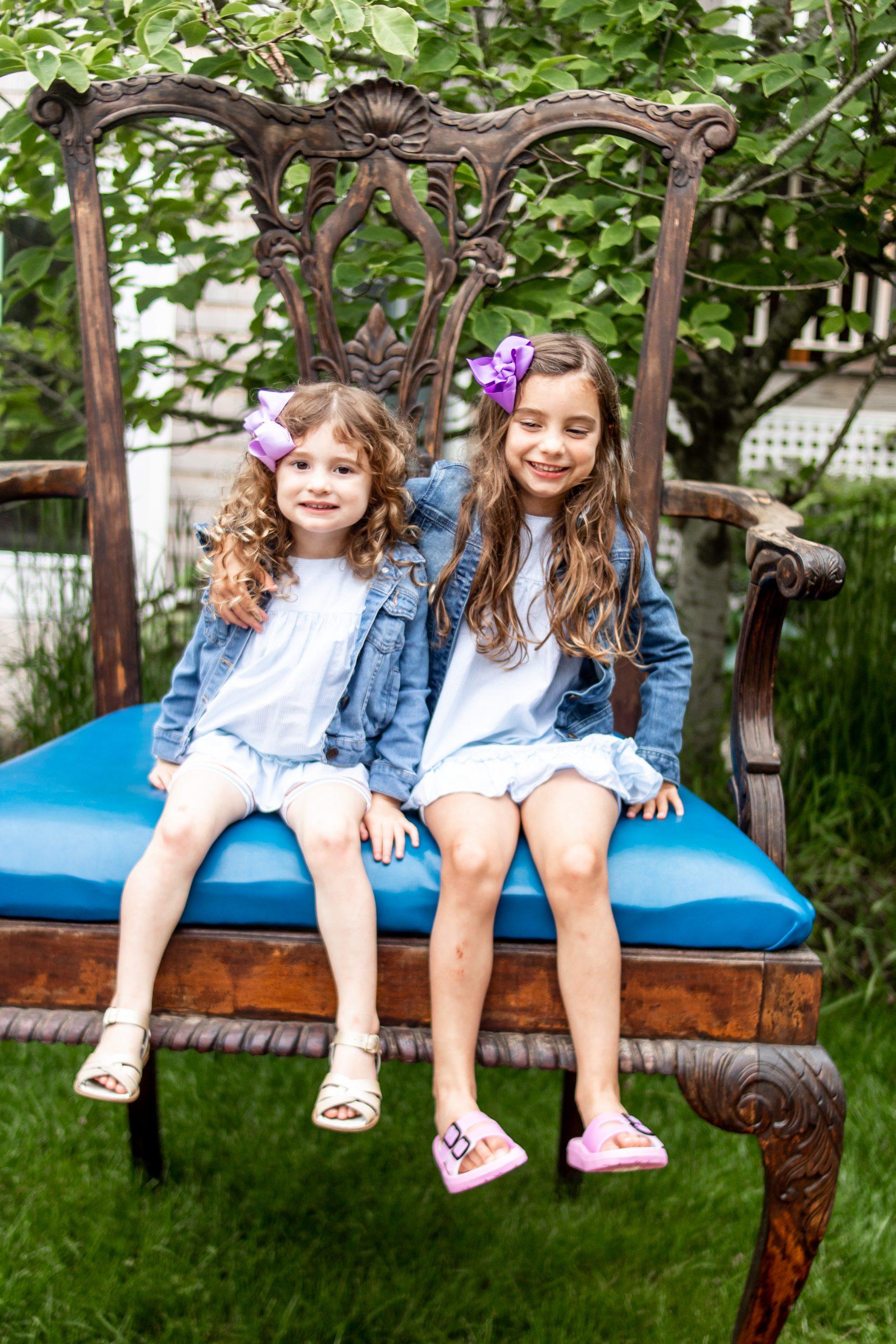girls sitting on giant chair at winnetu