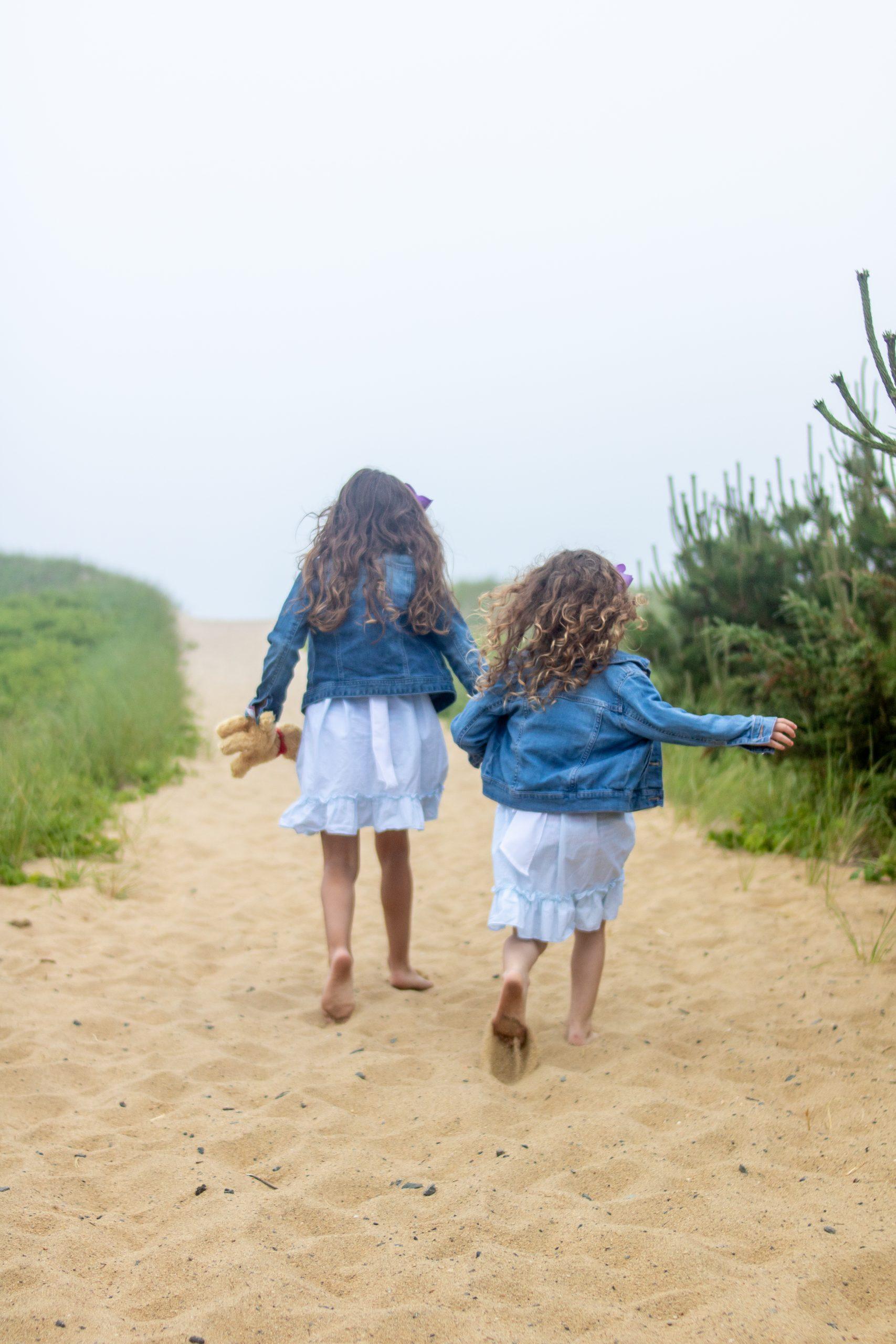 little girls running up beach hill south beach martha's vineyard