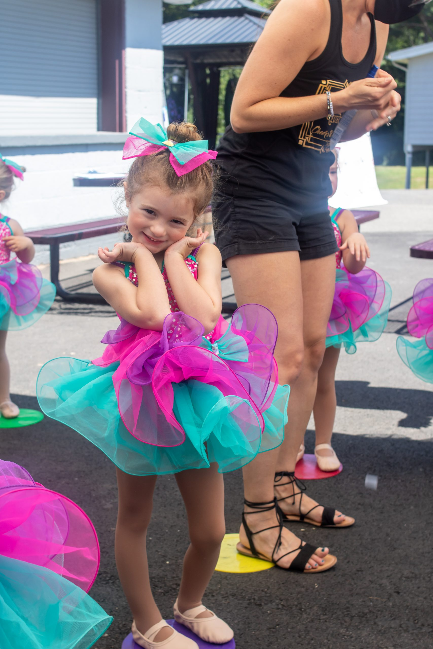 four year old in pink and green dance costume