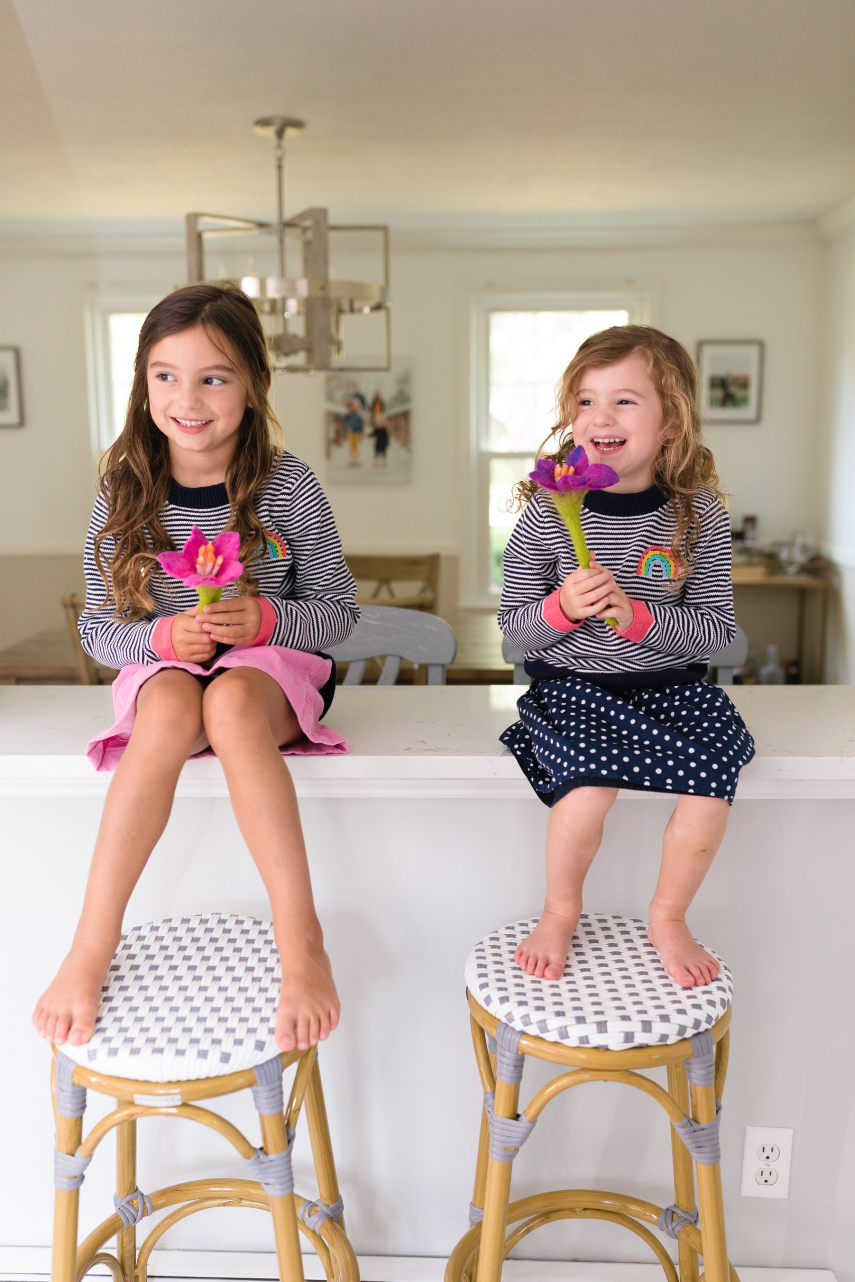 little girls in Joules sweaters with felt flowers in Life Lately post