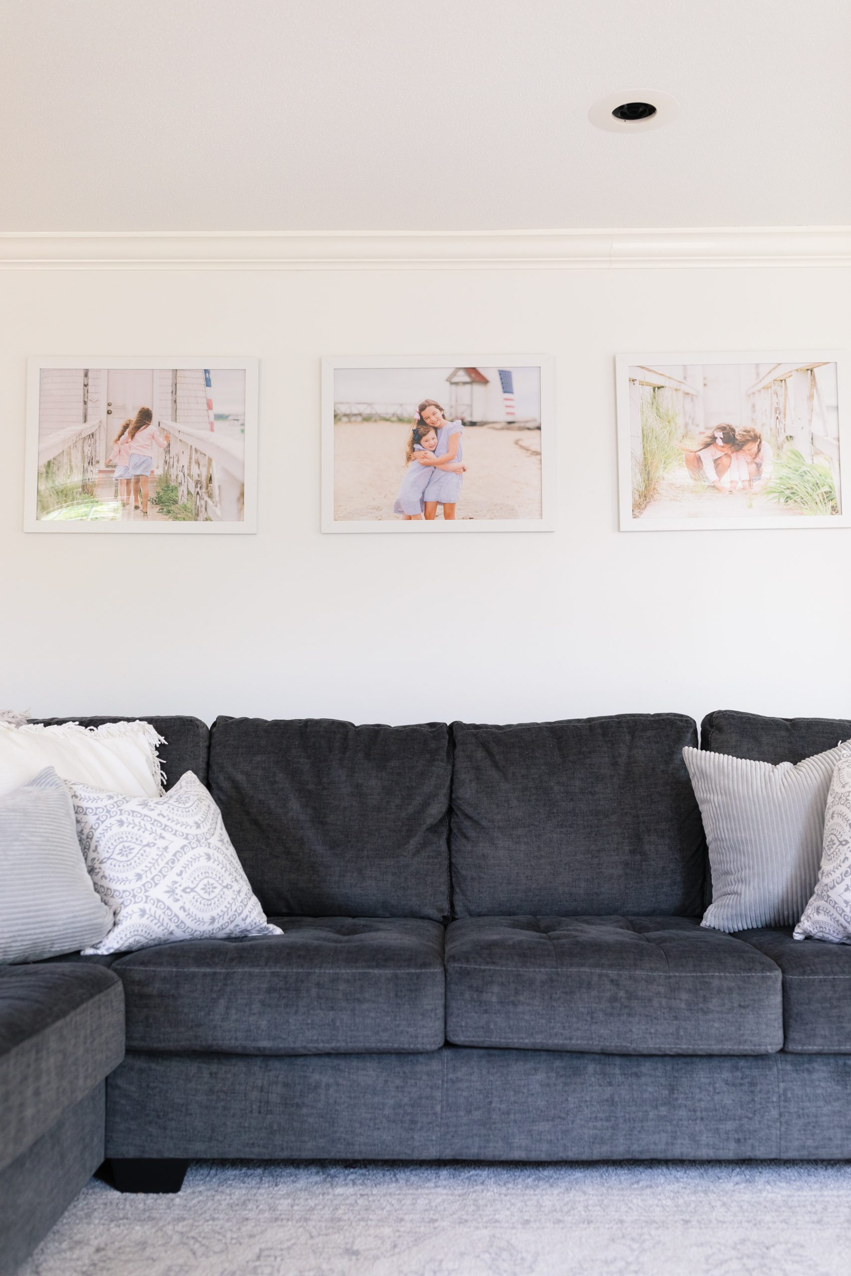enlarged prints hanging on wall above couch
