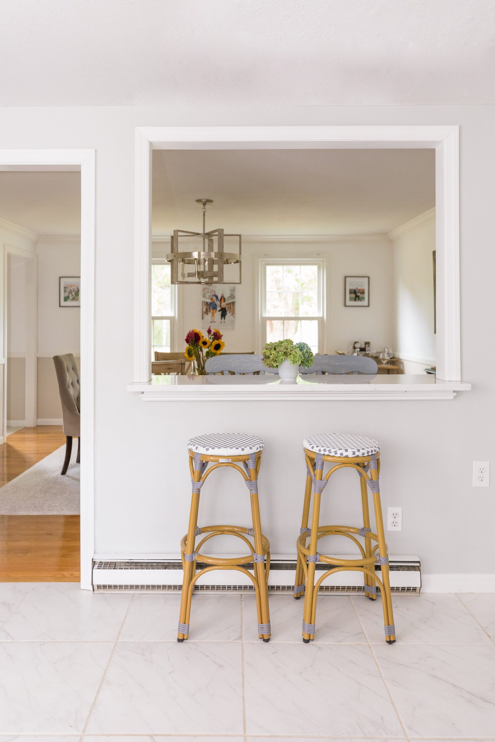 Breakfast Bar with white quartz countertop in kitchen with serena lily riviera dupe stools