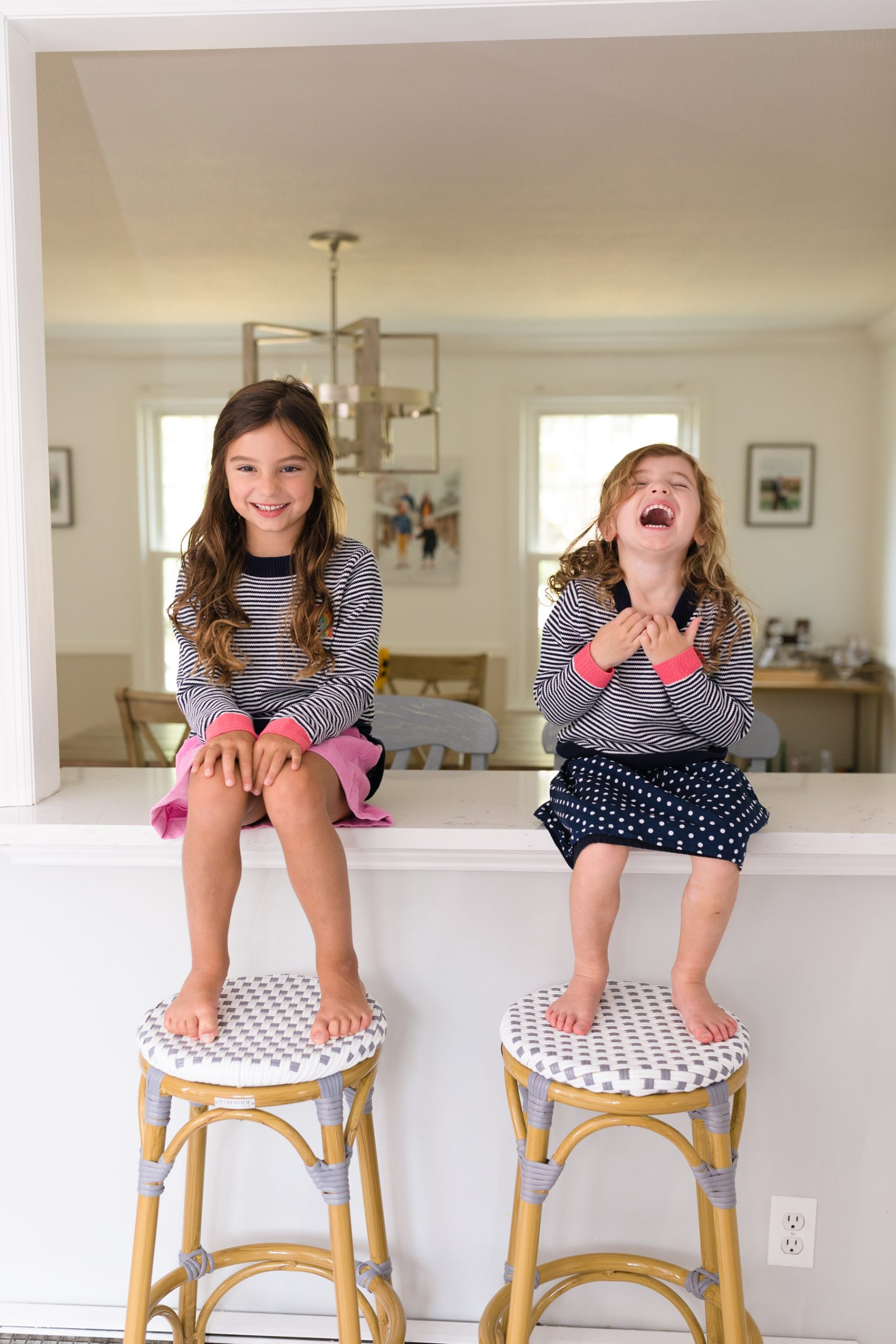 little girls laughing on countertop before school