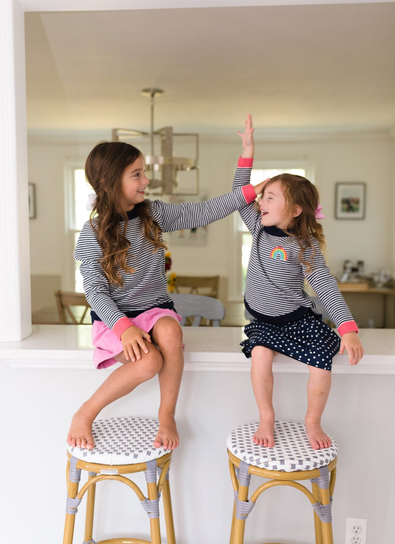 little girls being silly on counter before school