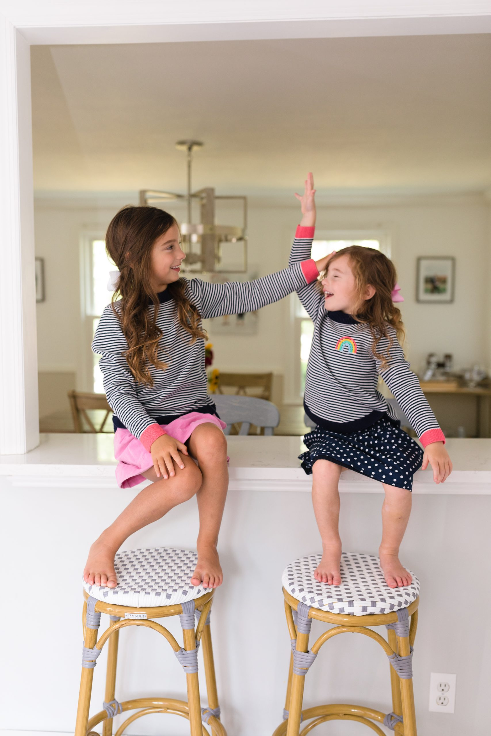 little girls playing on the countertop before school