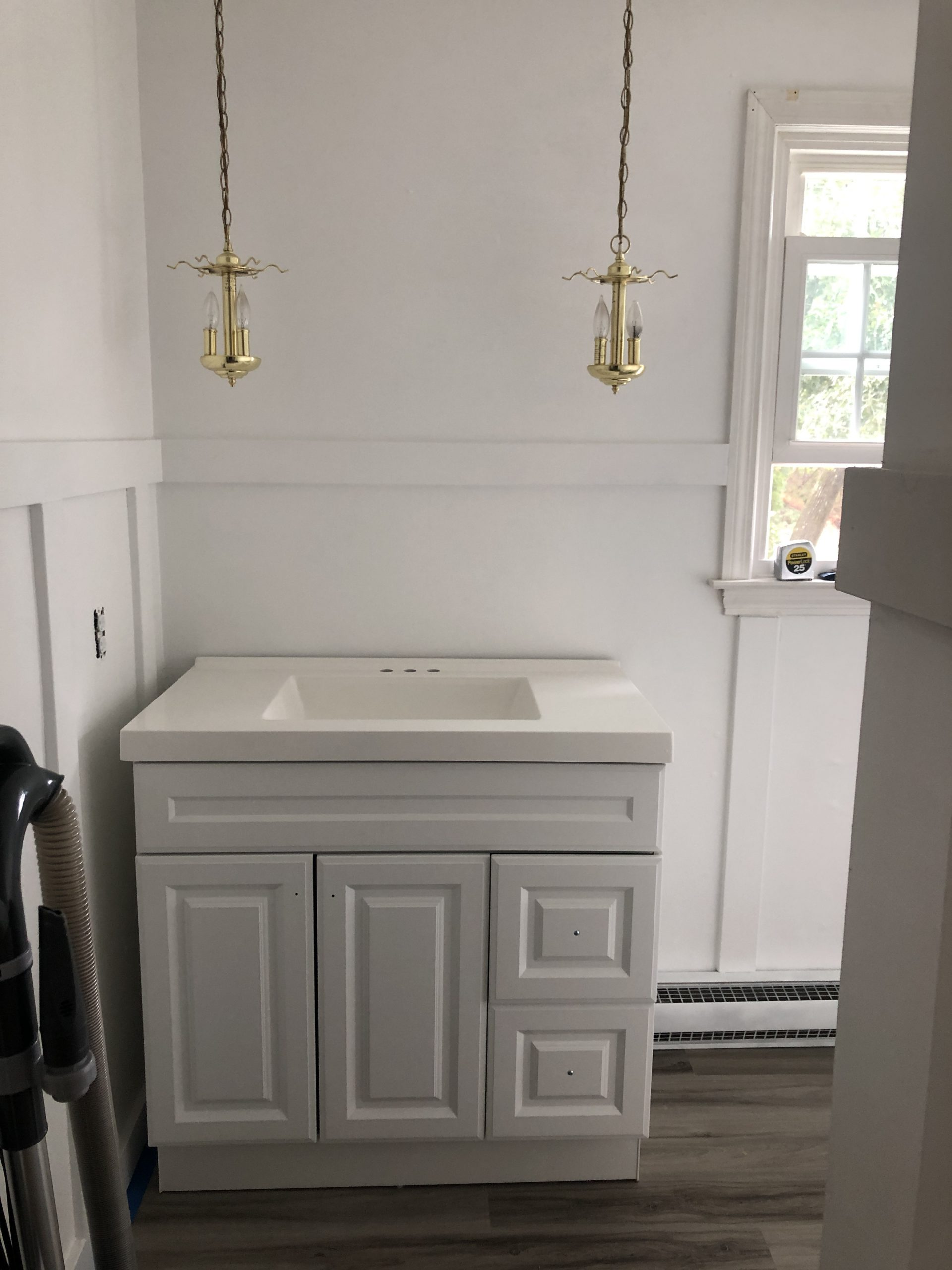 white vanity with white sink top bathroom remodel