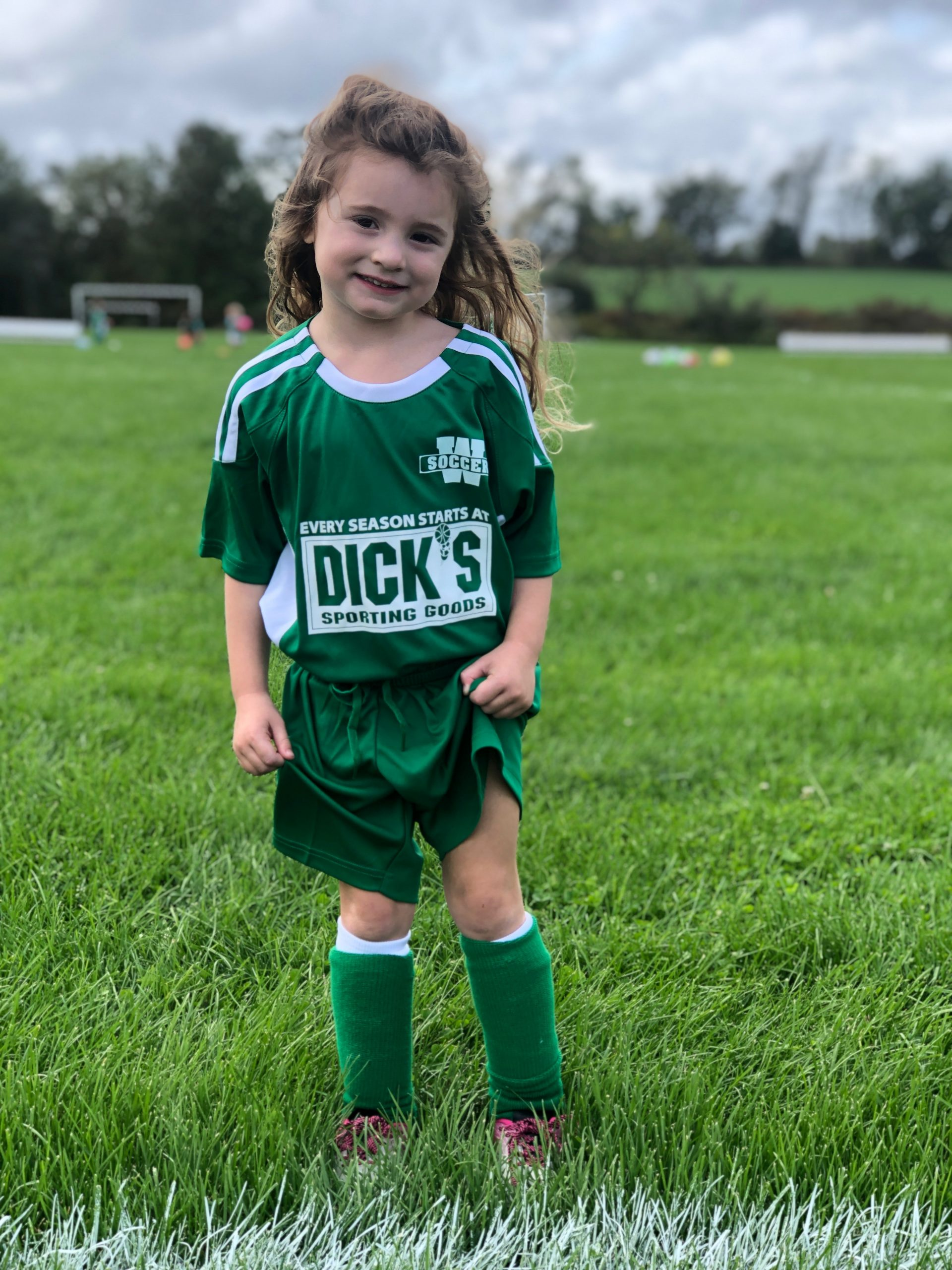 four year old in soccer uniform