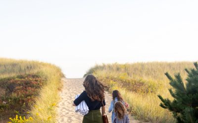 woman walking up the beach dunes in Marthas Vineyard with children