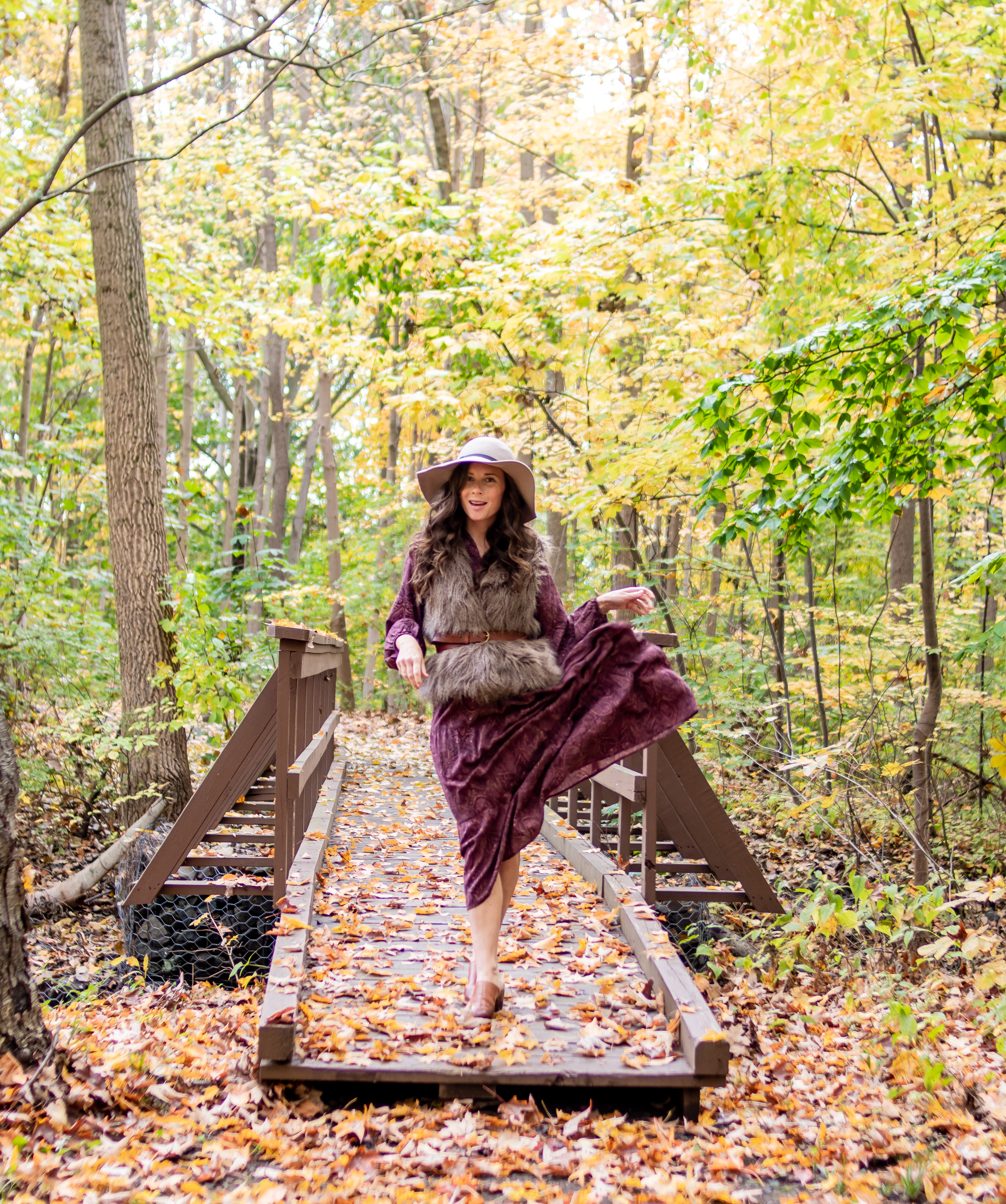 caitlin houston in maroon dress with fur vest and hat for fall